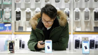 A man tries out a Samsung Electronics' smartphone at its store in Seoul, South Korea, January 23, 2017.