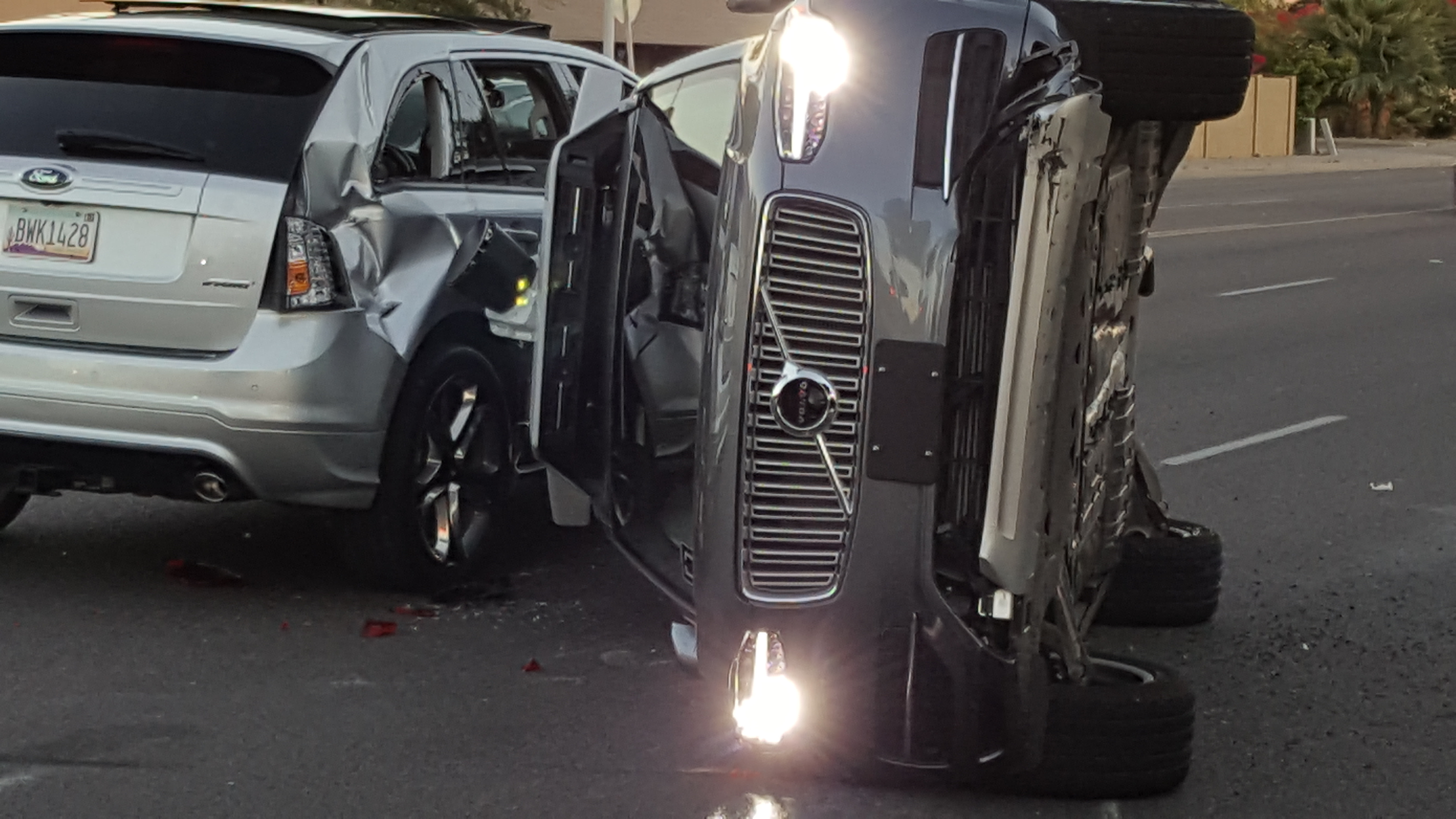 A self-driven Volvo SUV owned and operated by Uber Technologies Inc. is flipped on its side after a collision in Tempe, Arizona, U.S. on March 24, 2017. Picture taken on March 24, 2017.   Courtesy FRESCO NEWS/Mark Beach/Handout via REUTERS  ATTENTION EDITORS - THIS IMAGE WAS PROVIDED BY A THIRD PARTY. EDITORIAL USE ONLY.  MANDATORY CREDIT. - RTX32PLW