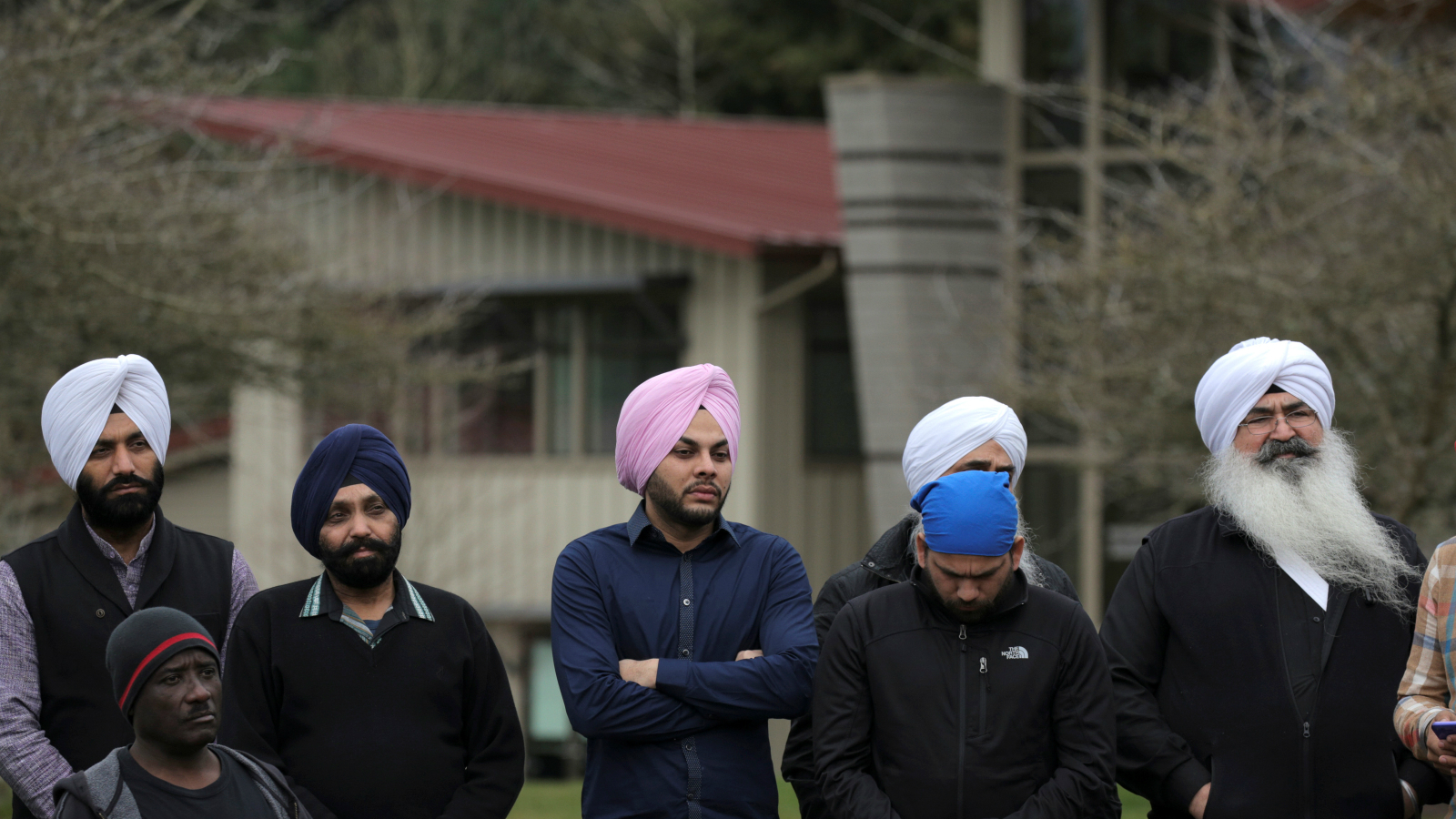 Sikh men listen during a vigil in honor of Srinivas Kuchibhotla, an immigrant from India who was recently shot and killed in Kansas, at Crossroads Park in Bellevue, Washington, U.S. March 5, 2017.