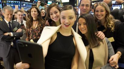 Miranda Kerr takes a selfie during Snap's IPO at the New York Stock Exchange on March 2, 2017.