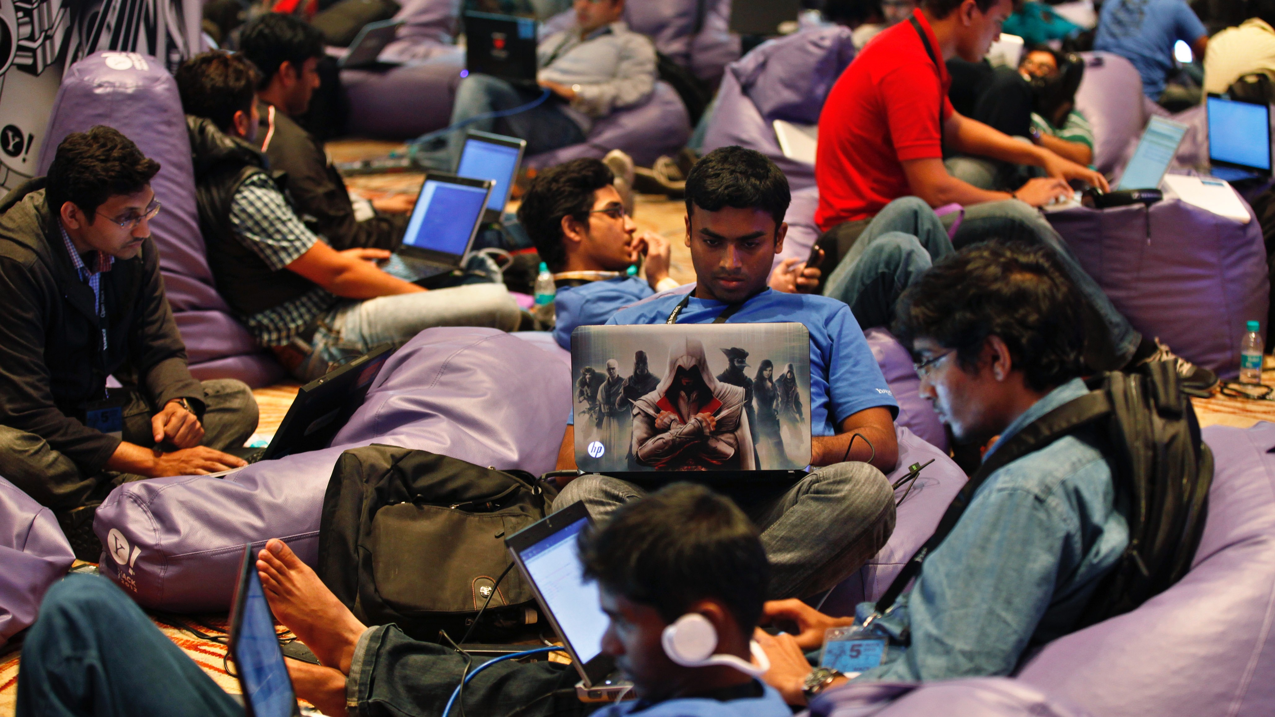 Participants work on their laptops during the fifth Open Hack in India in Bangalore, India, Sunday, Aug. 12, 2012. About 700 software engineers and developers took part in the 24-hour open hacking competition organized by Yahoo, which gives developers a chance to work together and build applications and product ideas using different technologies to develop something that can potentially solve a real-world problem that impact internet users. (AP Photo/Aijaz Rahi)