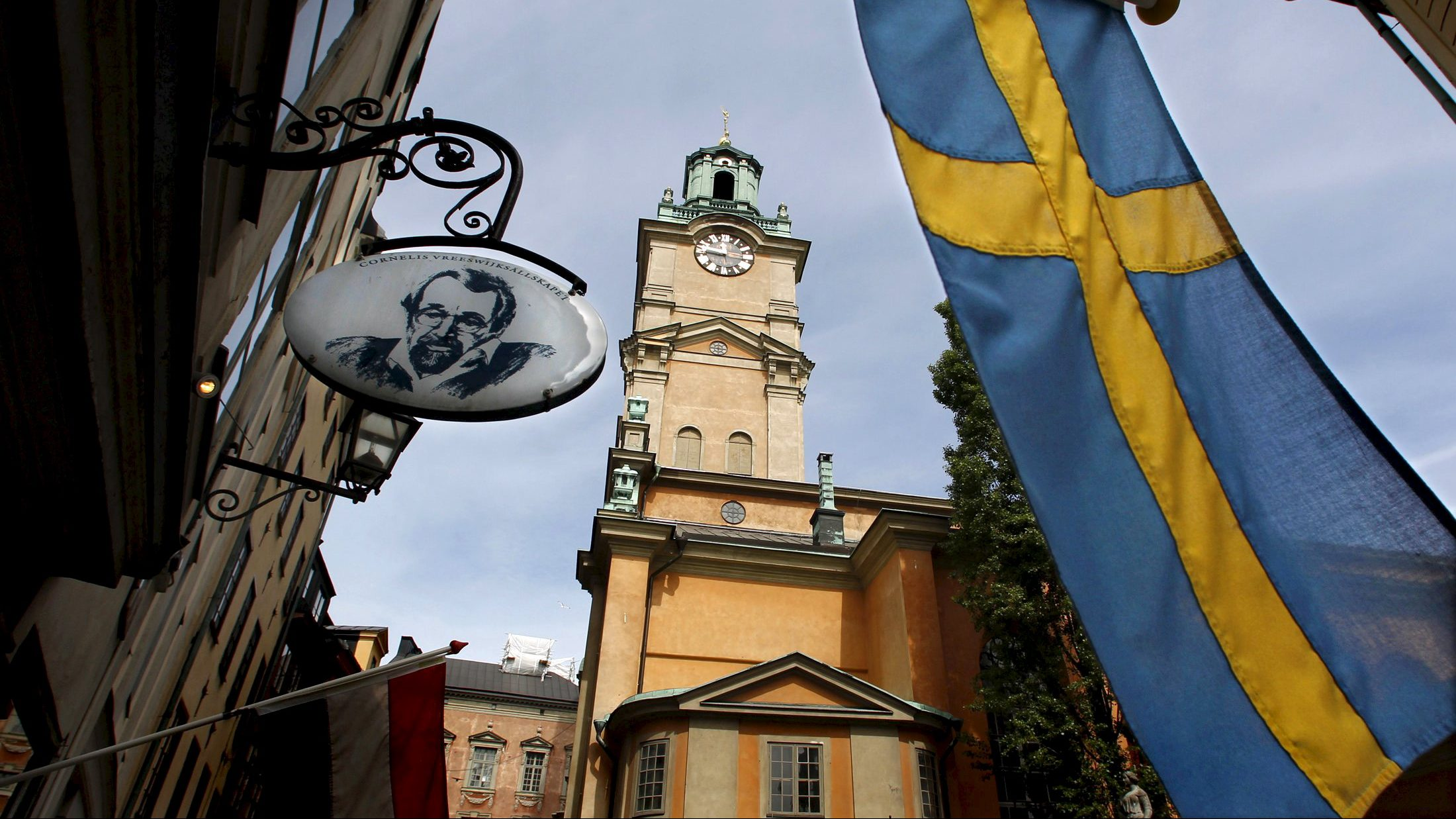 Sweden's flag is seen near Stockholm Cathedral in Gamla Stan or the Old Town district of Stockholm