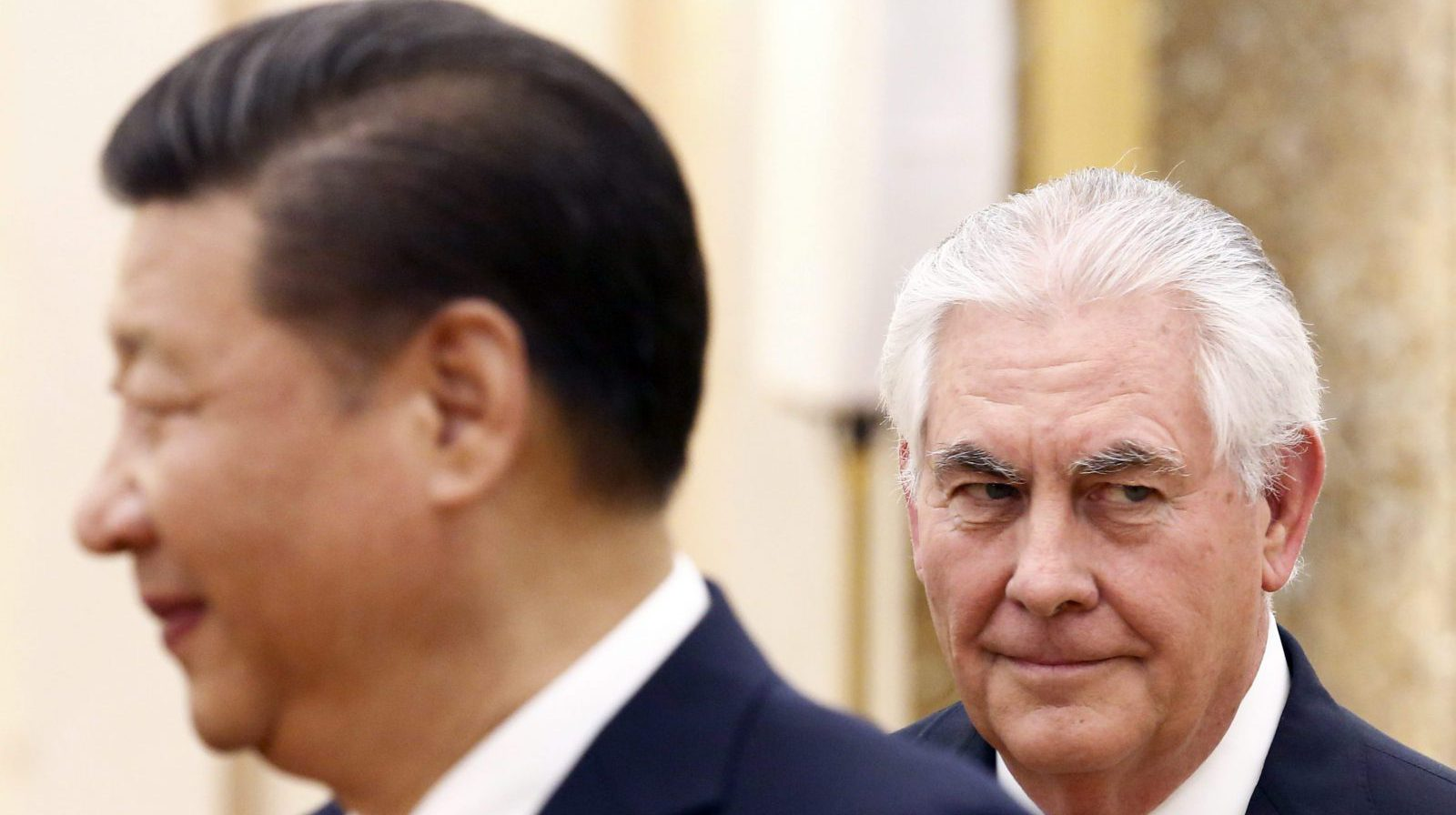 China's President Xi Jinping, left, stands near U.S. State of Secretary Rex Tillerson during a meeting at the Great Hall of the People in Beijing, China, Sunday, March 19, 2017.