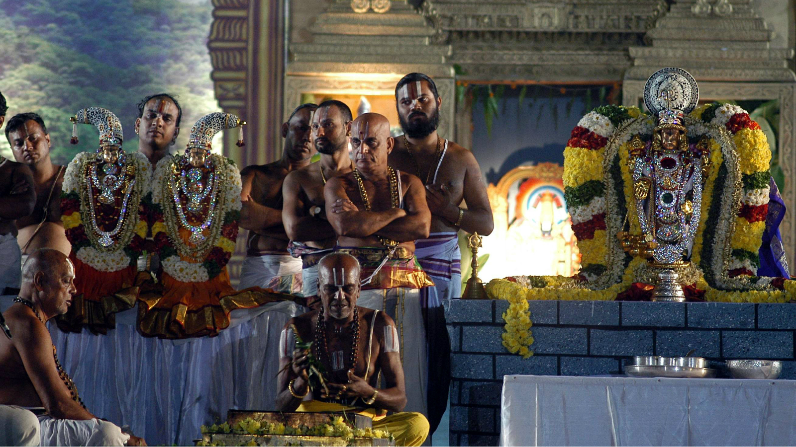 Hindu priests perform ritual prayers near the idols of Lord Balaji, right, and Goddess Padmawati and Bhu Devi, left, at a makeshift temple in Mumbai, India, Saturday, Dec. 2, 2006. The idols of Lord Balaji and Goddess Padmavati were brought from the Tirumala Tirupati Devasthanam to Mumbai for their traditional wedding ritual, in an event hosted by the South Indian Education Society.