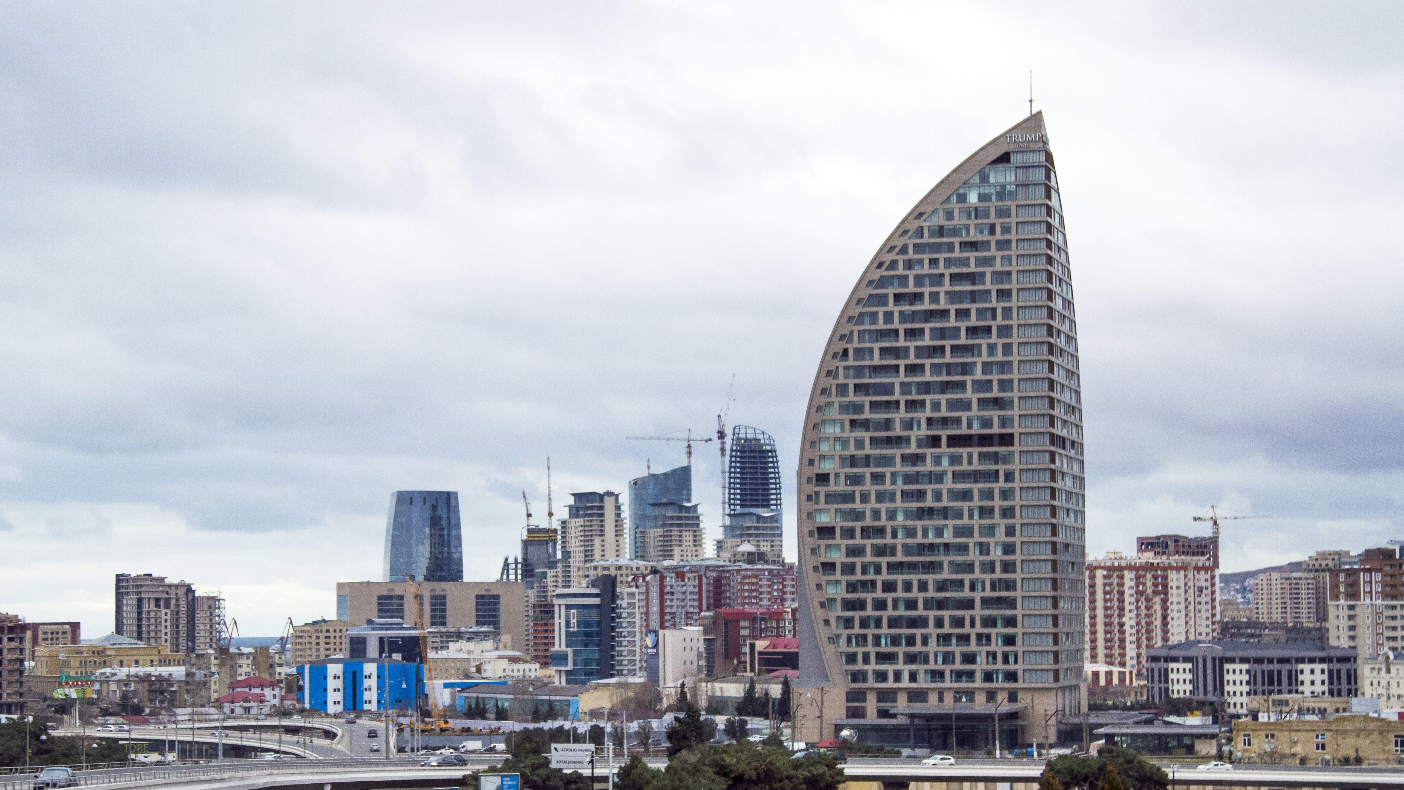 "FILE - In this Feb. 19, 2016, file photo, The Trump International Hotel, the highest building, is seen in Baku, Azerbaijan. Just six months before he launched his presidential campaign, Donald Trump announced a new real estate project in Baku. The partner: the 35-year-old son of an Azerbaijani minister suspected by U.S. diplomats of corruption and laundering money for Iran's military and described by them as ""notoriously corrupt."" Now, only weeks after Ivanka Trump released a publicity video of the nearly finished project, references to the Baku project have disappeared from Trump's website. (AP Photo/Aida Sultanova, File)"