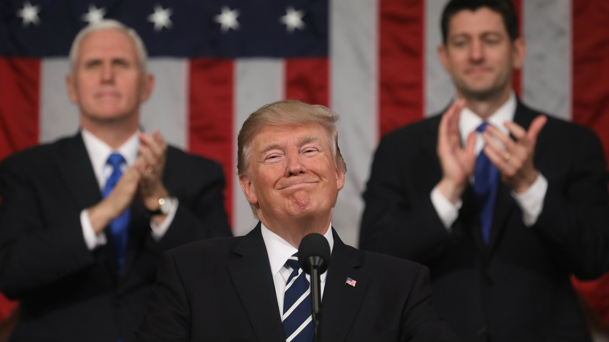 U.S. President Donald Trump is applauded while delivering his first address to a joint session of Congress