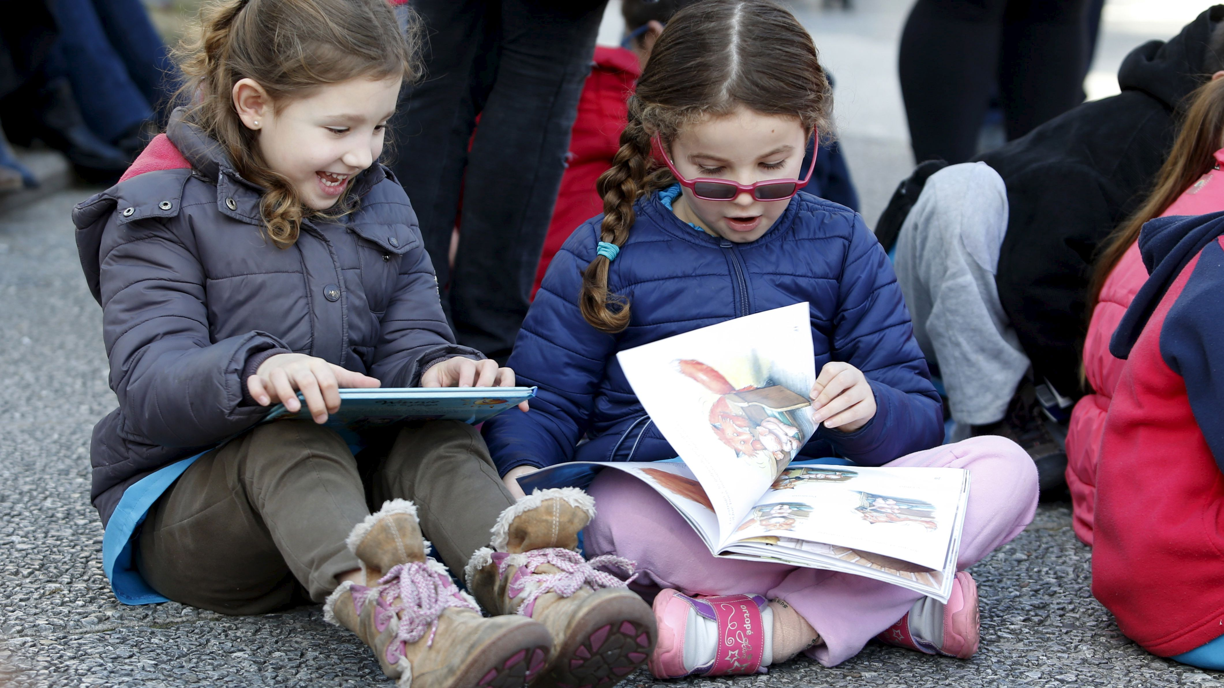 "Children read books at Montevideo's Independencia square while participating in the activity ""Al Aire Libro"" that encourages reading in public spaces, September 4, 2015."