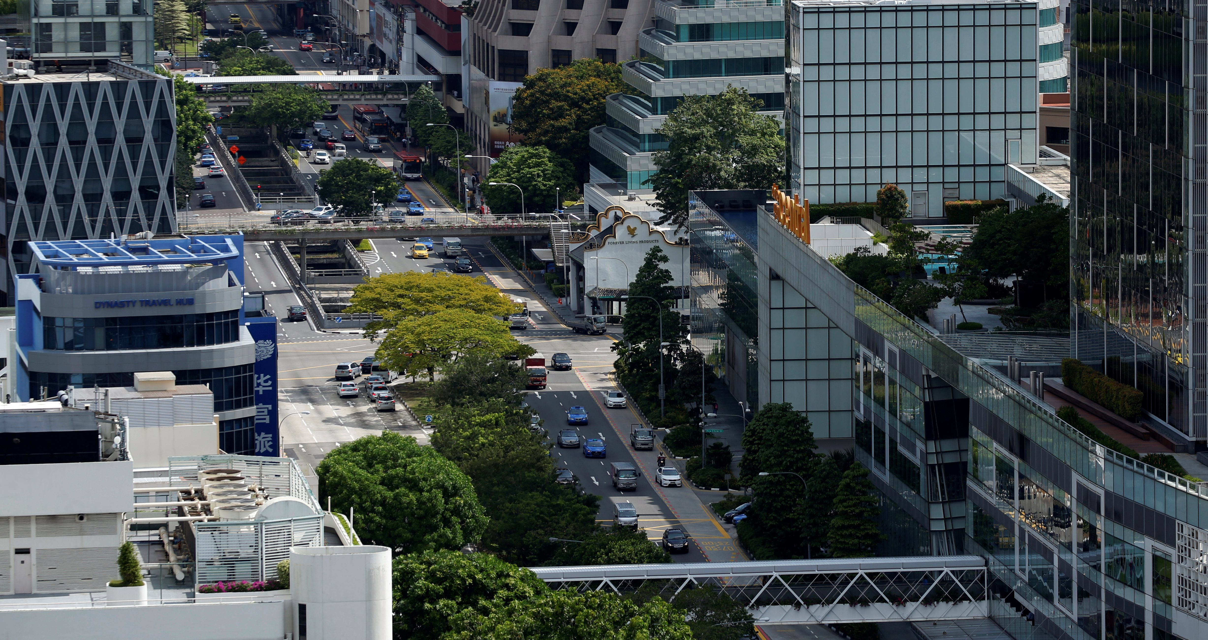 Cars ply the roads in downtown Singapore
