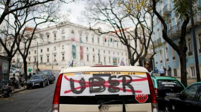 A taxi driver protests Uber.