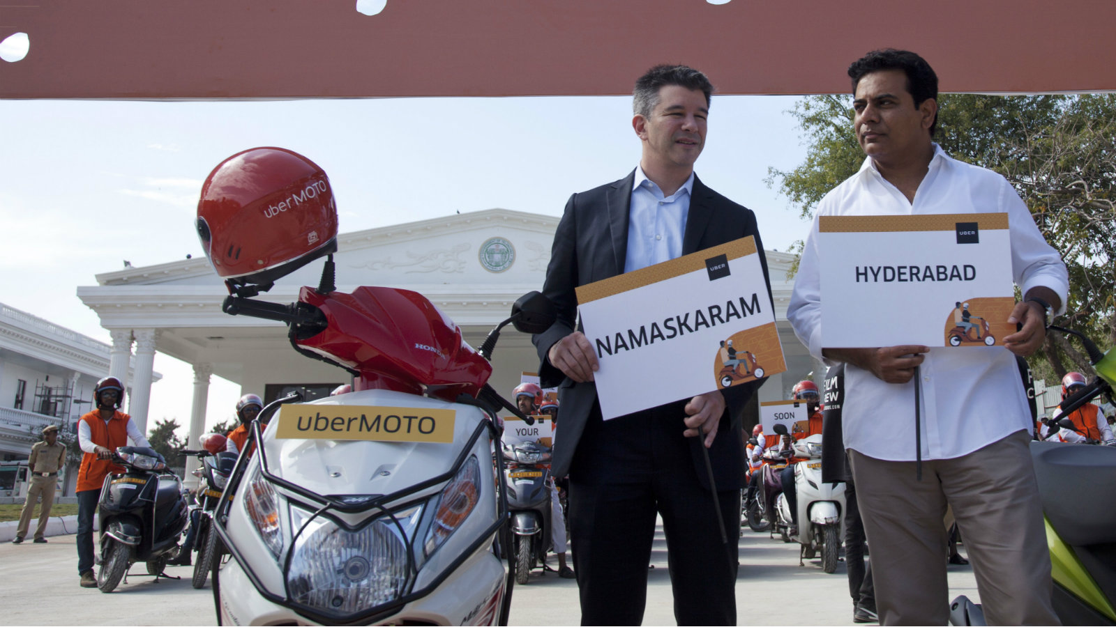 Uber CEO Travis Kalanick, center, poses with Telangana state minister for Information and Technology, Municipal Administration and Urban Development, K T Rama Rao, right, during the launch of Uber's bike-sharing product, uberMOTO, in Hyderabad, India, Tuesday, Dec. 13, 2016.
