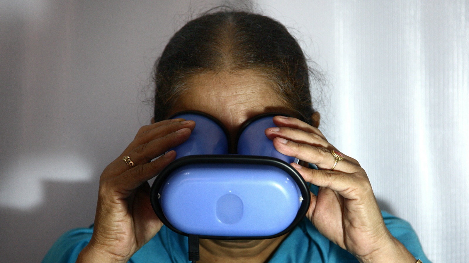 An Indian woman scans her eyes for enrollment of Aadhaar Number/ UID Card in Old Bhopal, Madhya Pradesh, India on 29 July 2011. The Unique Identification Authority of India (UIDAI) is an agency of the Government of India responsible for implementing the envisioned AADHAAR a unique identification project in India. The authority will aim at providing a unique number to all Indians and would provide a database of residents containing very simple data in biometrics. It is believed that Unique National IDs will help address the rigged state elections and widespread embezzlement that affects subsidies and poverty alleviation programs and addressing illegal immigration into India and terrorist threats is another goal of the program. Aadhar card to become the single source of identity verification card in India for many Sources. It provides the government with accirate and enough information on any individual residents of India. It also provides online authentication services for agencies or companies those who wish to validate an individual identity, news reports said. Aadhaar is a 12-digit unique number which the Unique Identification Authority of India (UIDAI) will issue for all residents in India.