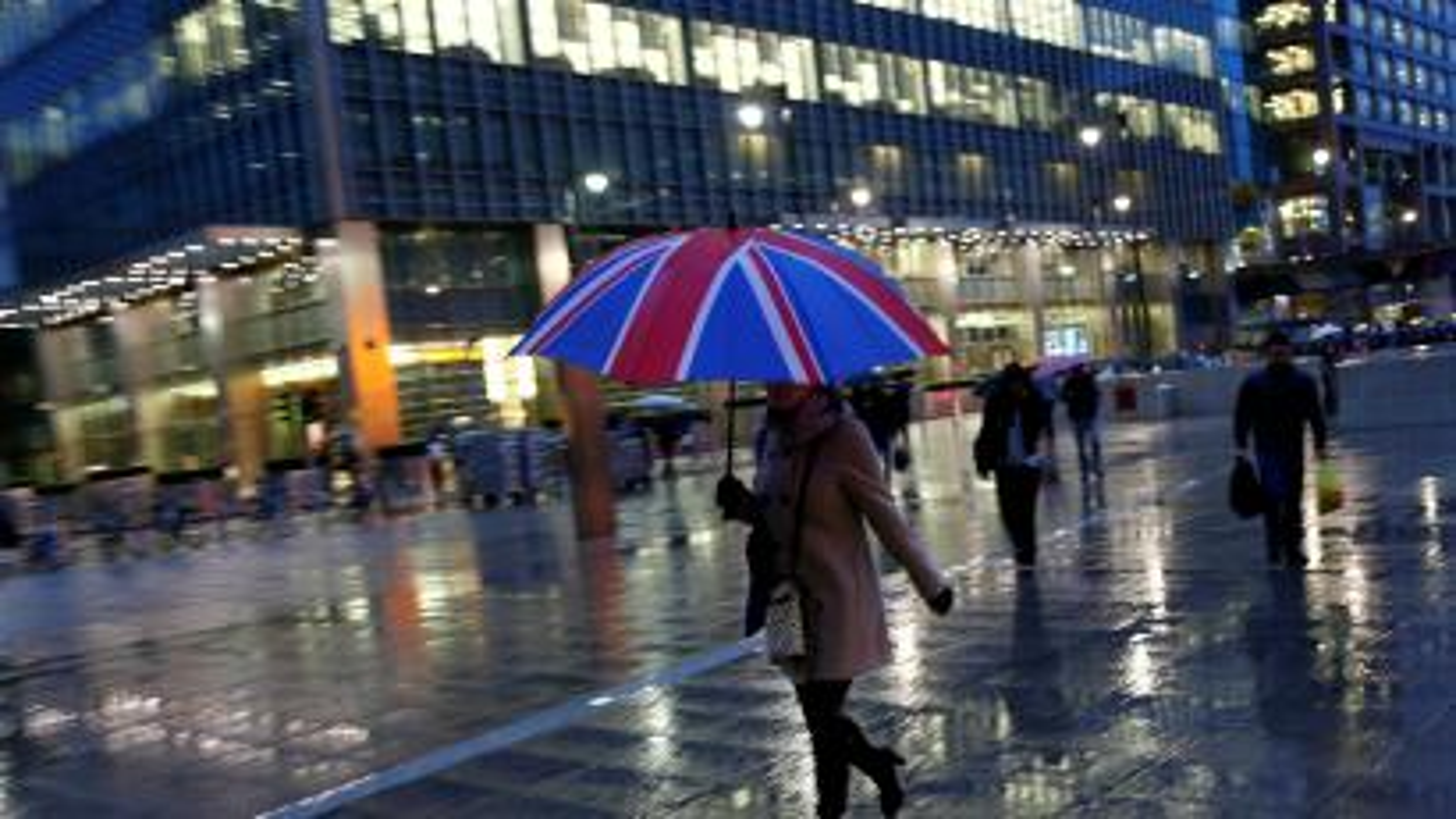 Union jack umbrella in the rain in Canary Wharf, London