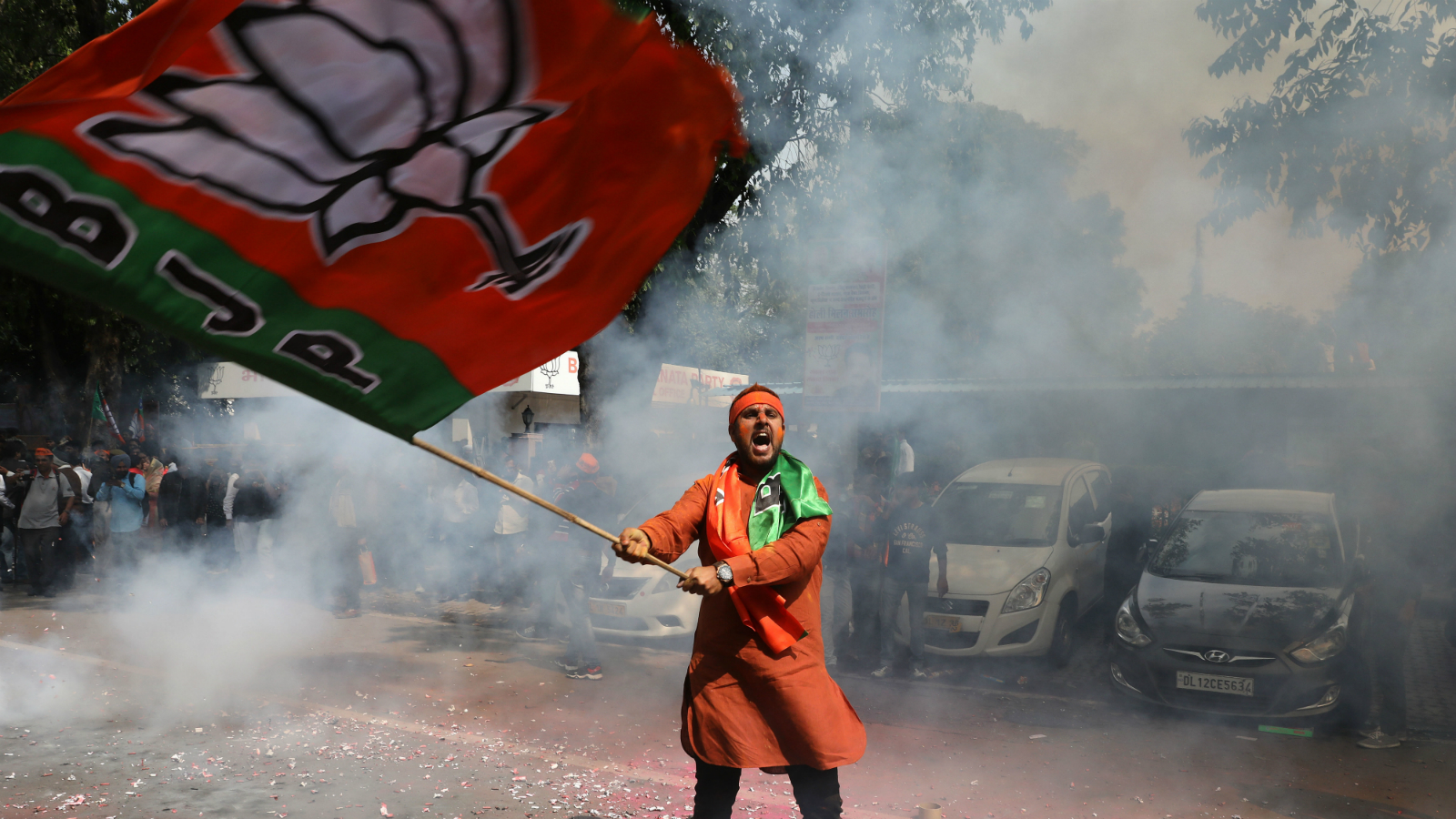 An Indian Bharatiya Janata Party (BJP) supporter celebrates as BJP leads in Uttar Pradesh state in assembly elections BJP in New Delhi, India, 11 March 2017. The trend shows that BJP is leading on most of the seats in Uttar Pradesh Assembly elections.