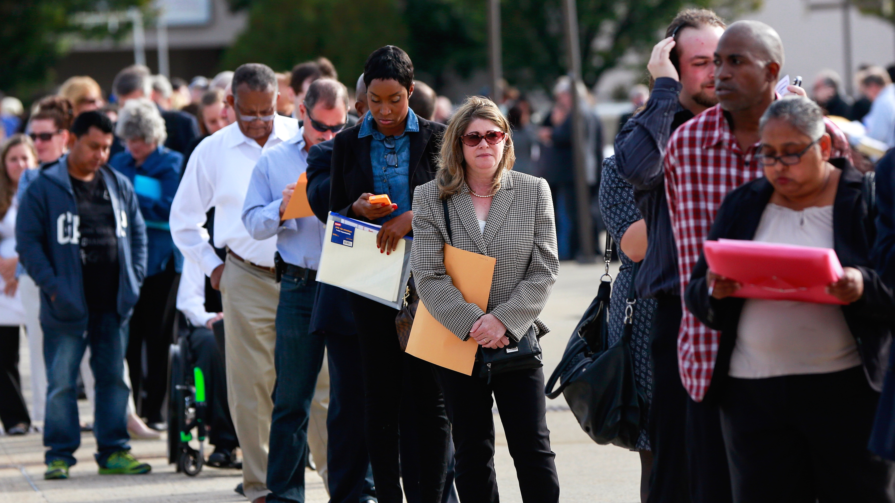 Job seekers stand in line.