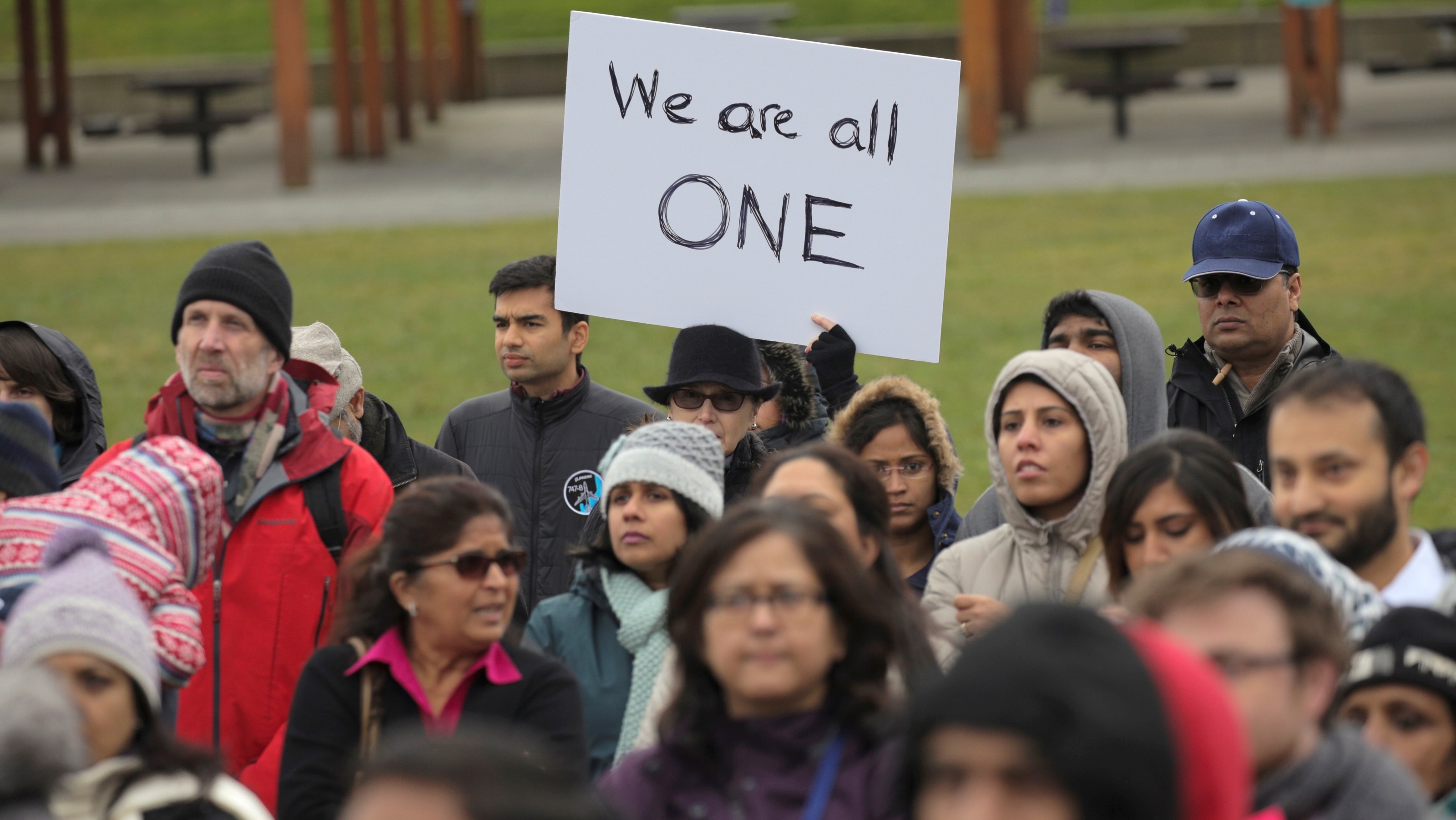 People listen during a vigil in honor of Srinivas Kuchibhotla, an immigrant from India who was recently shot and killed in Kansas, at Crossroads Park in Bellevue, Washington, U.S. March 5, 2017. REUTERS/David Ryder - RTS11KM6