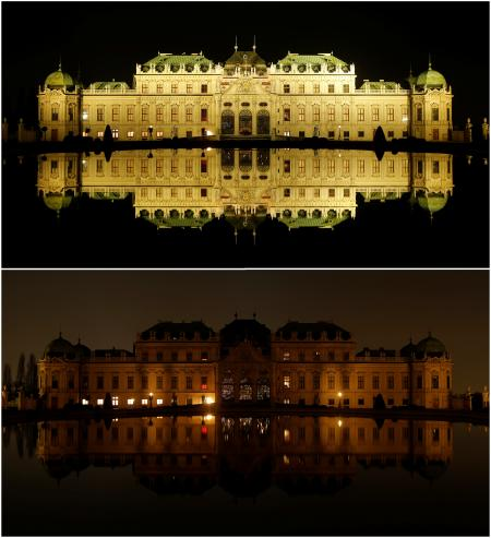 A combination photo shows Belvedere palace and its reflection in a pond before (top) and after the lights were switched off for Earth Hour in Vienna, Austria, March 25, 2017.