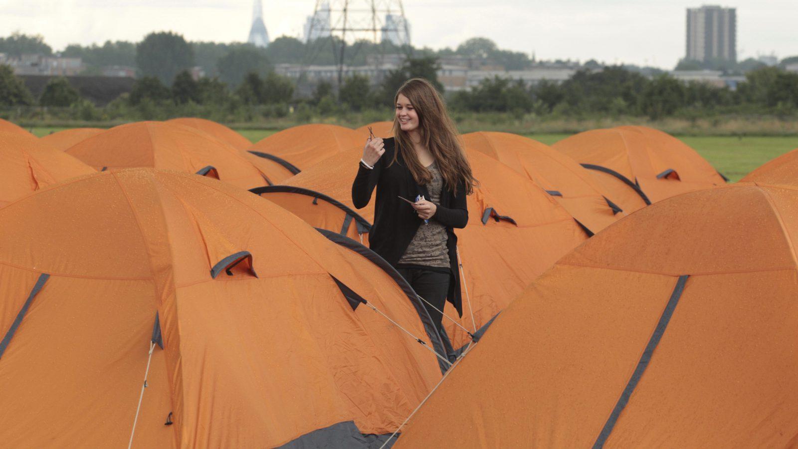 Volunteer at Olympic campsite.