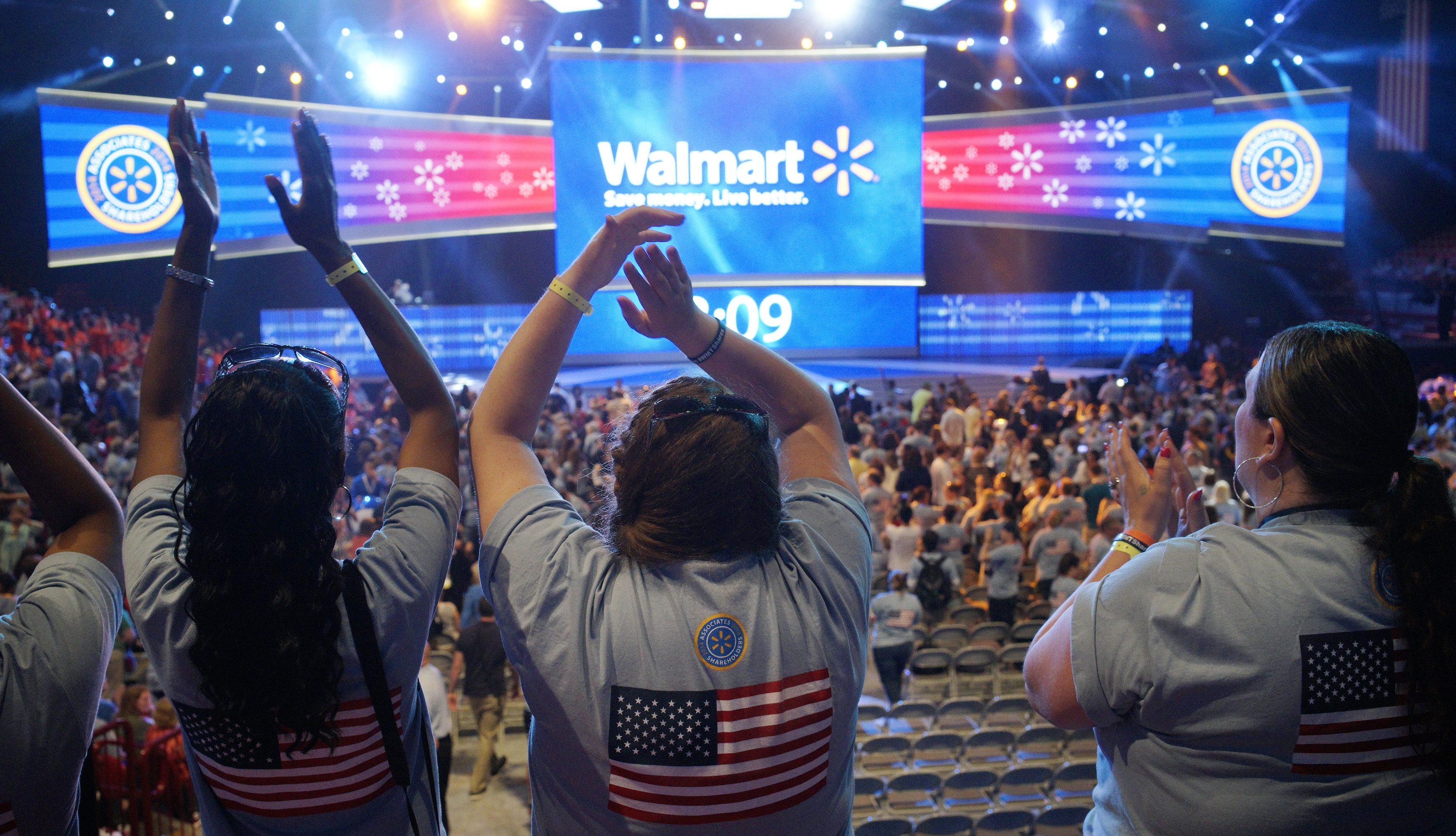 Walmart employees cheer at the Walmart U.S. associates meeting in Fayetteville, Arkansas June 4, 2014. The meeting was part of Walmart's annual shareholder meeting.