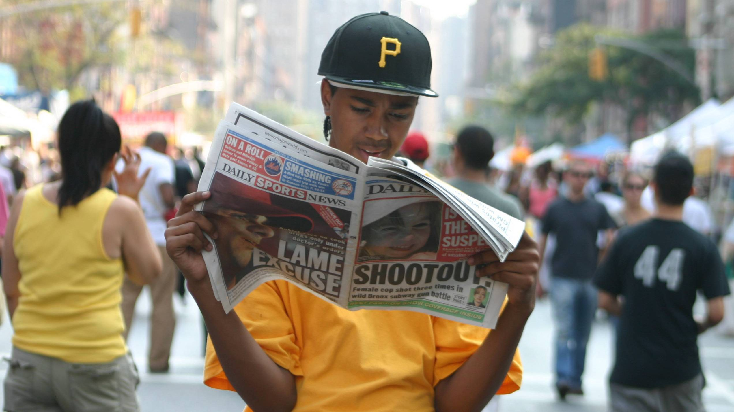young person reading news
