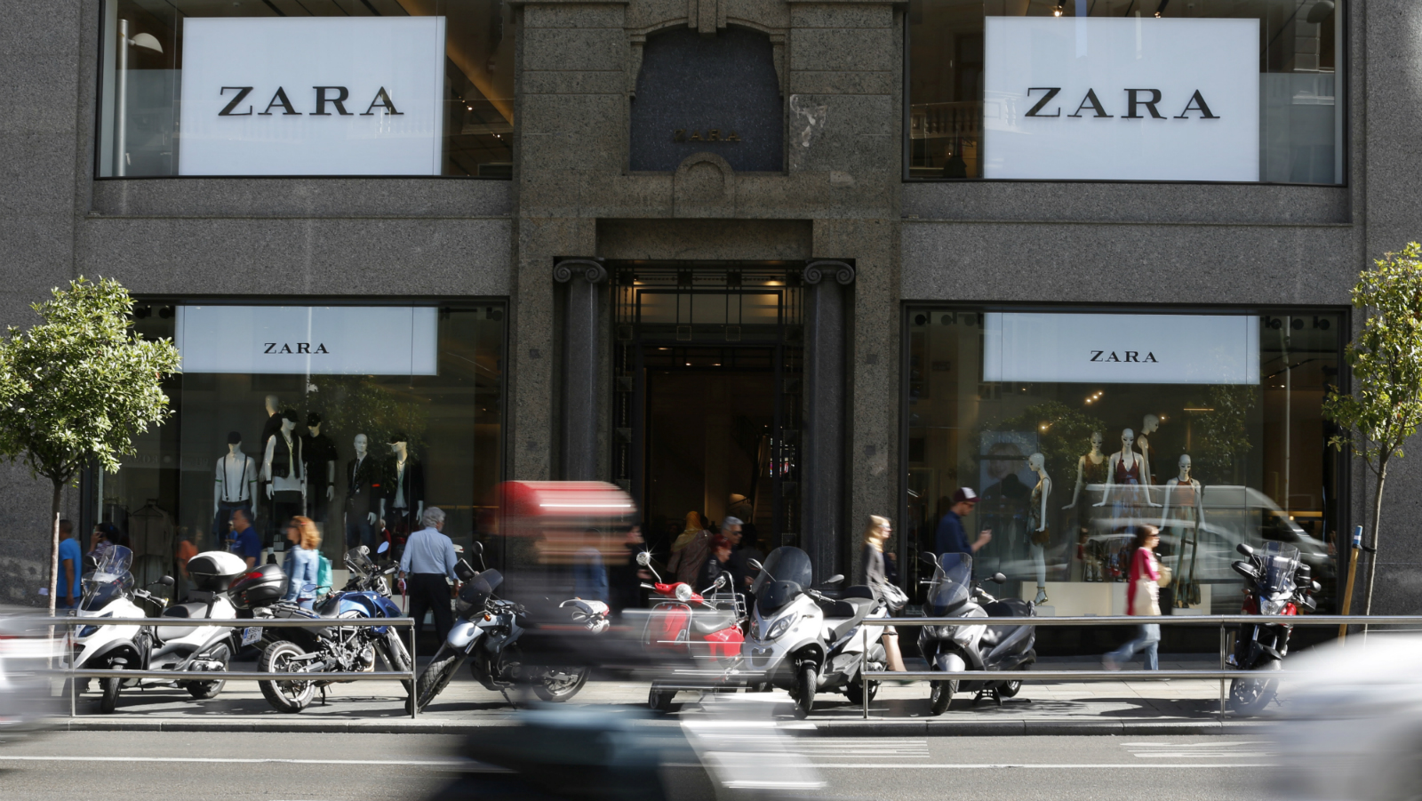 A scooter passes in front of a Zara store in Madrid, Spain, June 15, 2016.