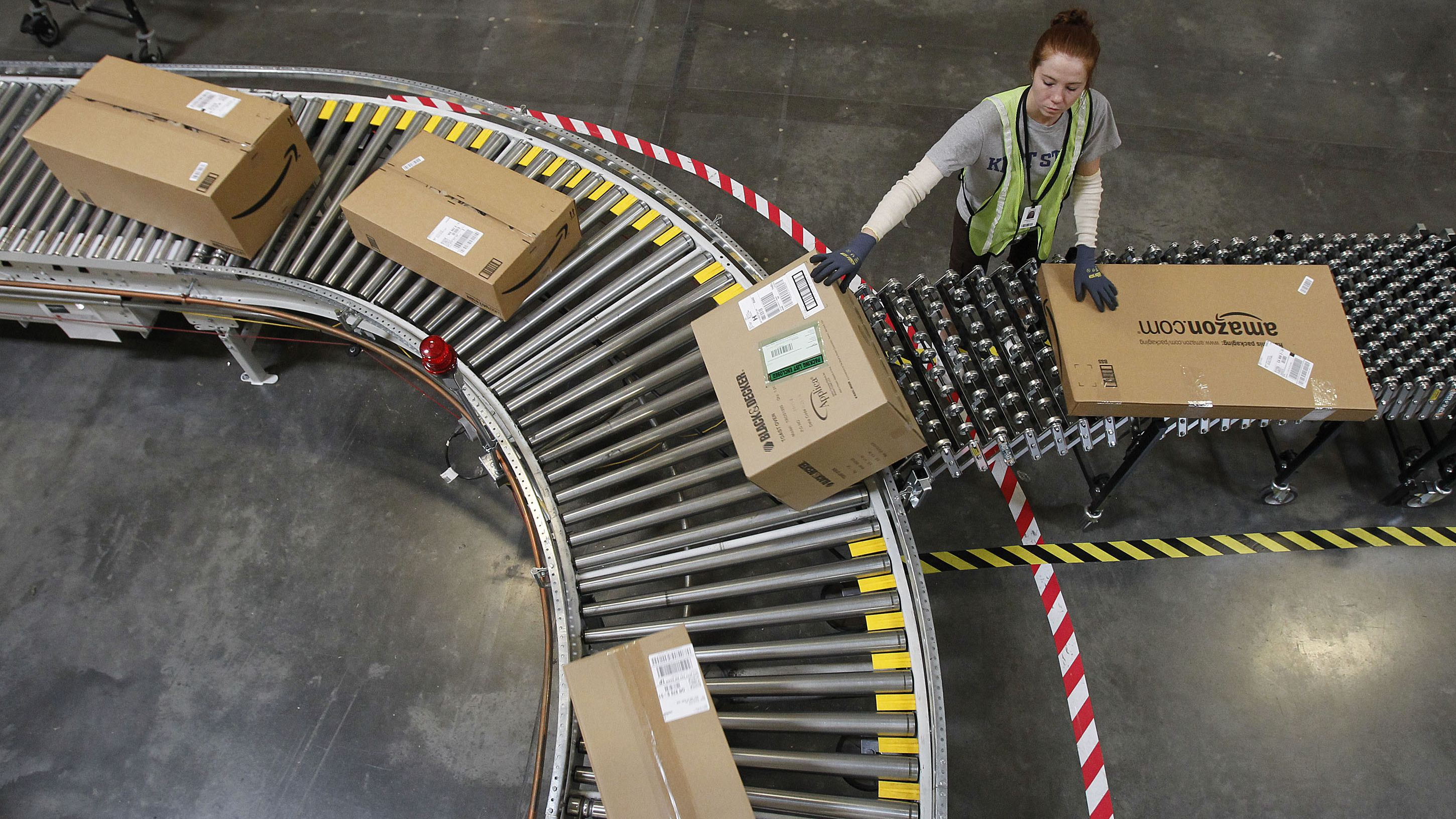 In this Nov. 11, 2010 photo, Katherine Braun sorts packages toward the right shipping area at an Amazon.com fulfillment center, in Goodyear, Ariz. (AP Photo/Ross D. Franklin)