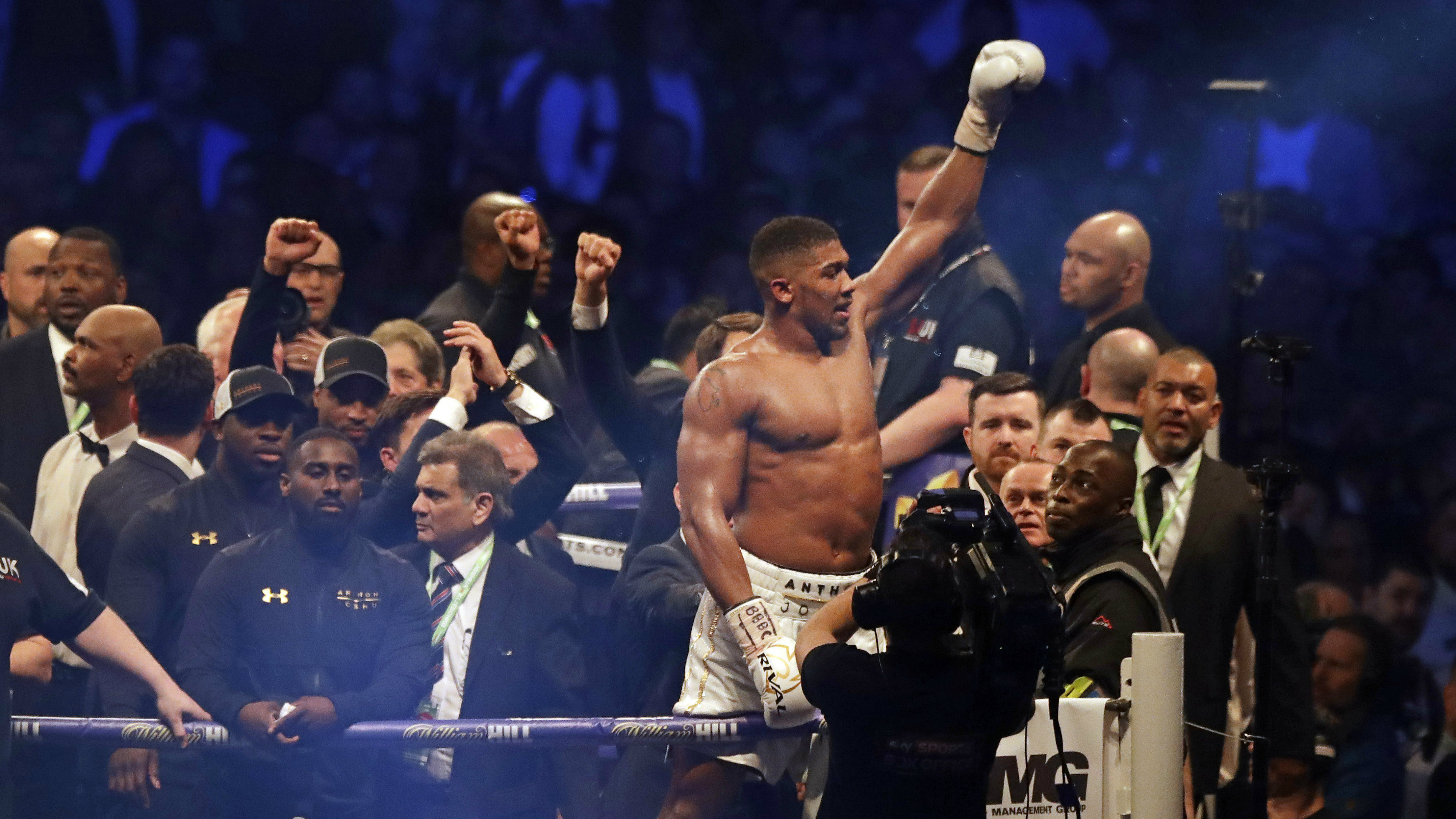 British boxer Anthony Joshua celebrates after beating Ukrainian boxer Wladimir Klitschko in a fight for Joshua's IBF and the vacant WBA Super World and IBO heavyweight titles at Wembley stadium in London, Saturday, April 29, 2017. Joshua won with an 11th round stoppage.