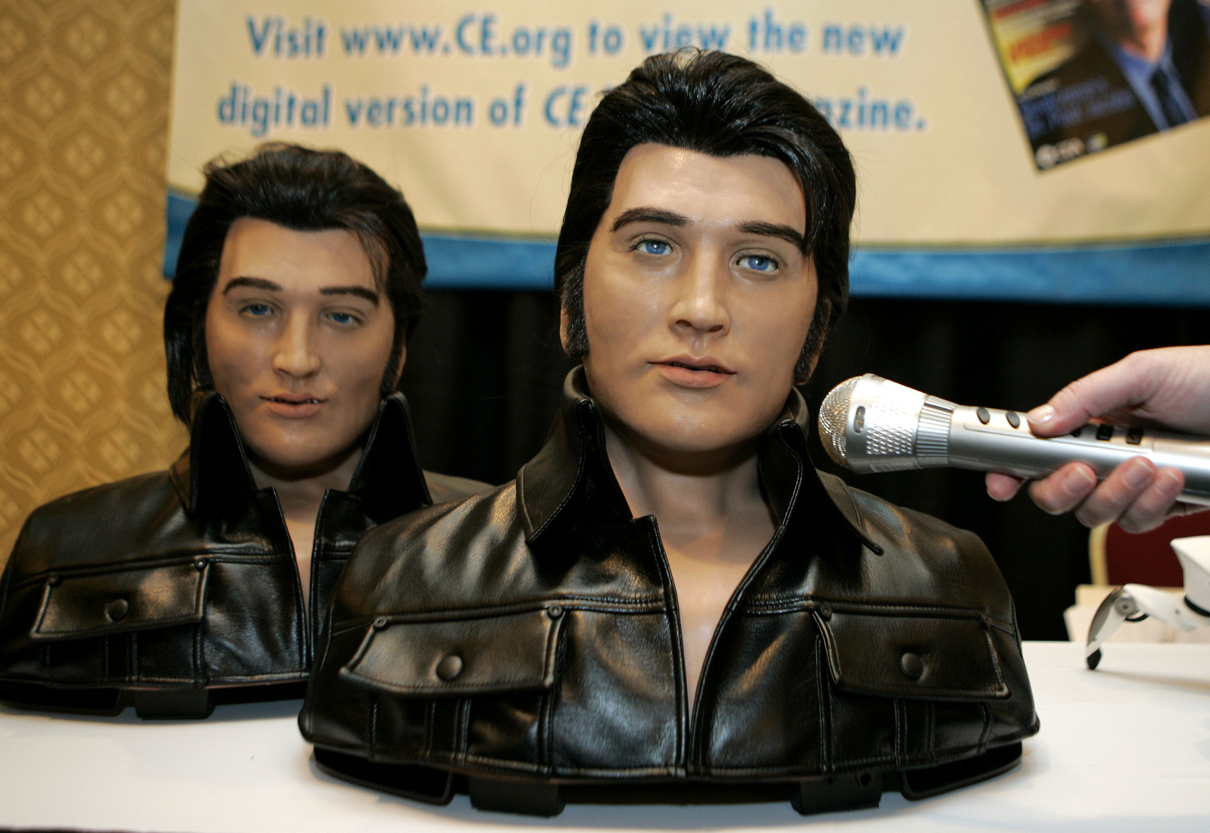 """WowWee Alive Elvis robots are showcased during the media preview of the Consumer Electronics Show in Las Vegas on Saturday, Jan. 6. 2007.  The robots sing eight different Elvis songs including """" Love me Tender"""" and """"Hound Dog."""" (AP Photo/Jae C. Hong)"""