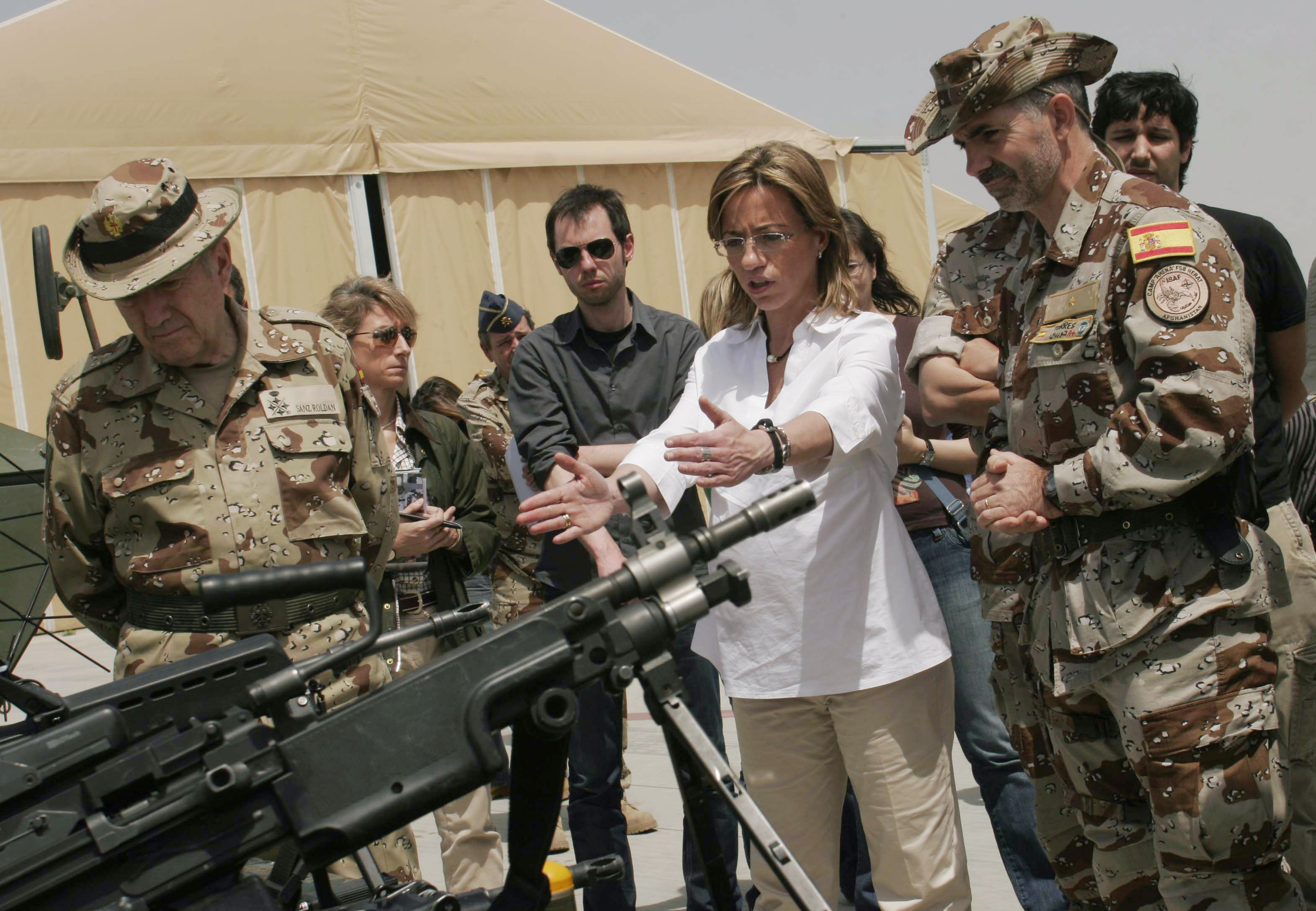 Spain's Defence Minister Carme Chacon, second right, gestures as she meets Spanish troops who are part of the International Security Assistant Force (ISAF) after she arrived in Herat province southwest of Kabul, Afghanistan
