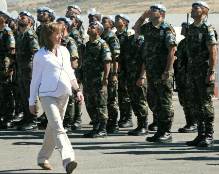 Spaish Defense Minister Carme Chacon reviews an honor guard of the Spanish United Nations peacekeeping force in Lebanon.