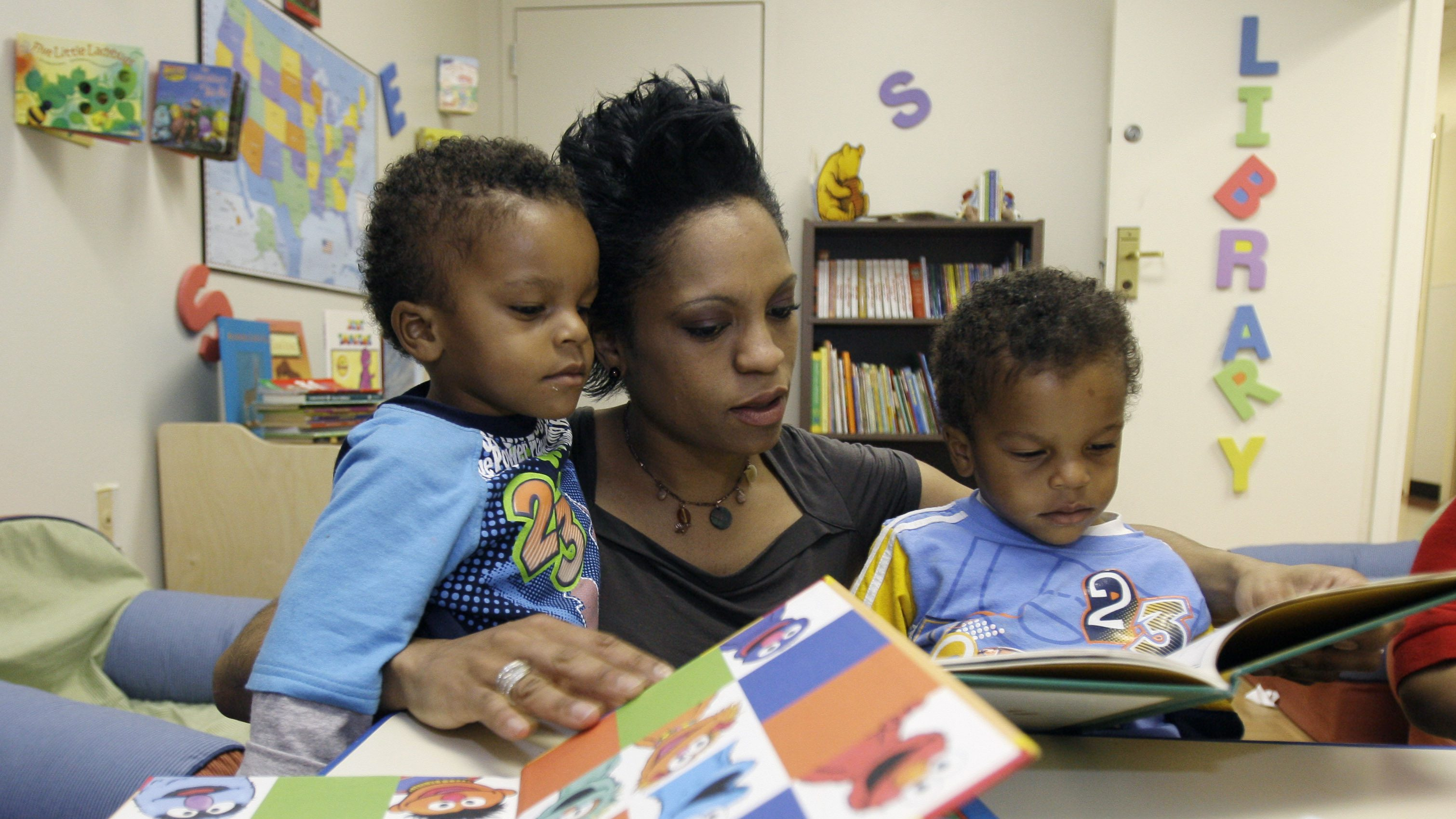 **HFR 12:01 A.M. MARCH 10** Rascheita Power, center, reads to her 2-year old twin sons, Mahdi Jalloul, left, and Kamal Jalloul at a family homeless shelter, Friday, March 6, 2009, in Dallas. According to a new report by the National Center on Family Homelessness, Texas is the worst place in the nation for homeless children, and current economic conditions will push even more families with young children out of their homes. (AP Photo/Matt Slocum)