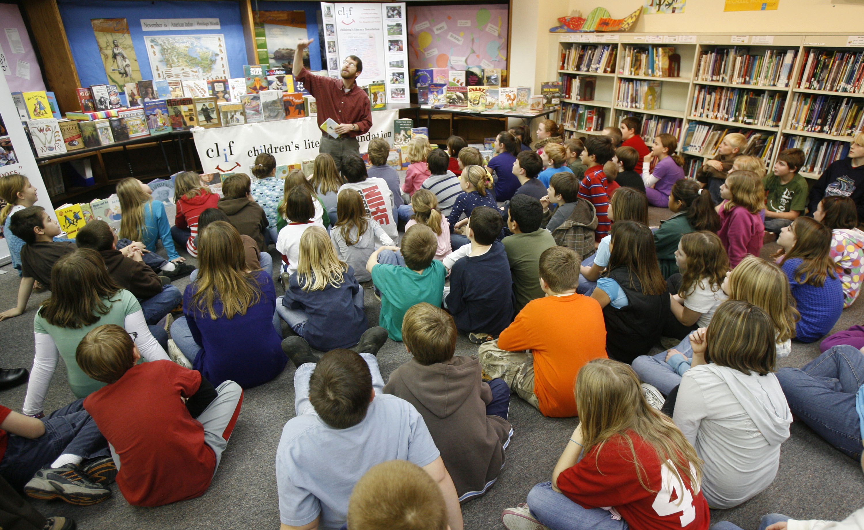 Duncan McDougall , founder of the Children's Literacy Foundation, reads to elementary students in Georgia, Vt., Monday, Dec. 7, 2009. The Vermont nonprofit raises money to hand deliver new books to schools, libraries, and shelters across Vermont and New Hampshire to promote reading and writing in under served rural areas. (AP Photo/Toby Talbot)