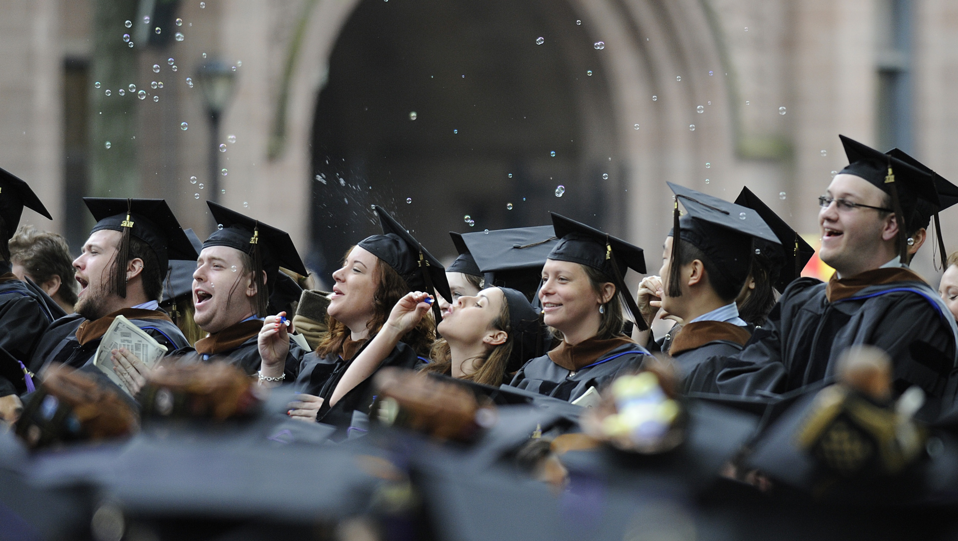 Graduates celebrate during commencement exercises at Yale University in New Haven, Conn., Monday, May 23, 2011.  (AP Photo/Jessica Hill)