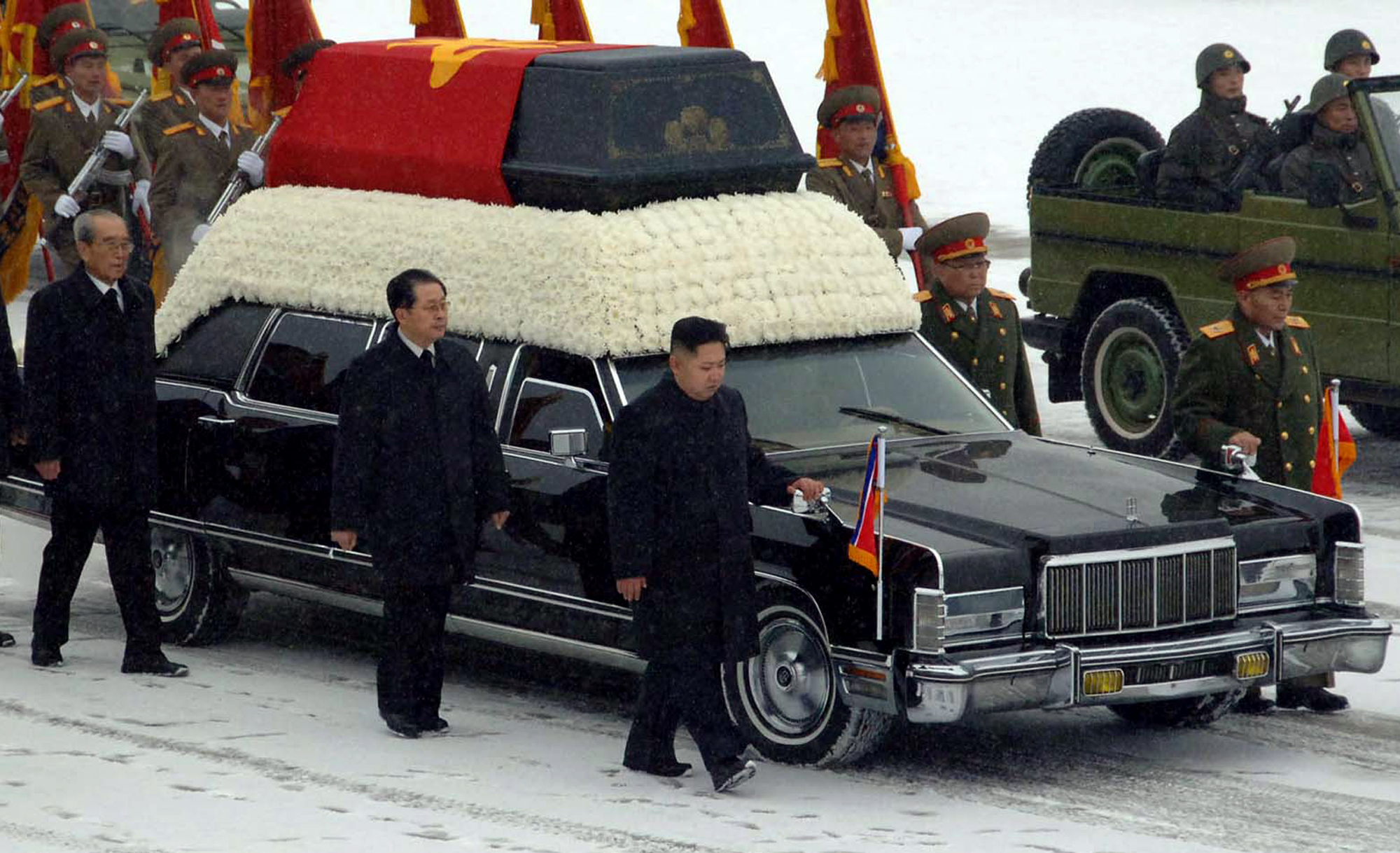 In this Wednesday, Dec. 28, 2011 photo released by the Korean Central News Agency and distributed in Tokyo, Dec. 29, 2011 by the Korea News Service, North Korea's next leader, Kim Jong Un, front right, walks beside the hearse carrying the body of his late father and North Korean leader Kim Jong Il during the funeral procession in Pyongyang, North Korea. Behind Kim Jong Un, in order are Jang Song Thaek, Kim Jong Il's brother-in-law and vice chairman of the National Defense Commission and Kim Ki Nam.  At far right is Ri Yong Ho, the Vice Marshal of the Korean People's Army. Behind him is People's Armed Forces Minister Kim Yong Chun.   (AP Photo/Korean Central News Agency via Korea News Service) JAPAN OUT UNTIL 14 DAYS AFTER THE DAY OF TRANSMISSION