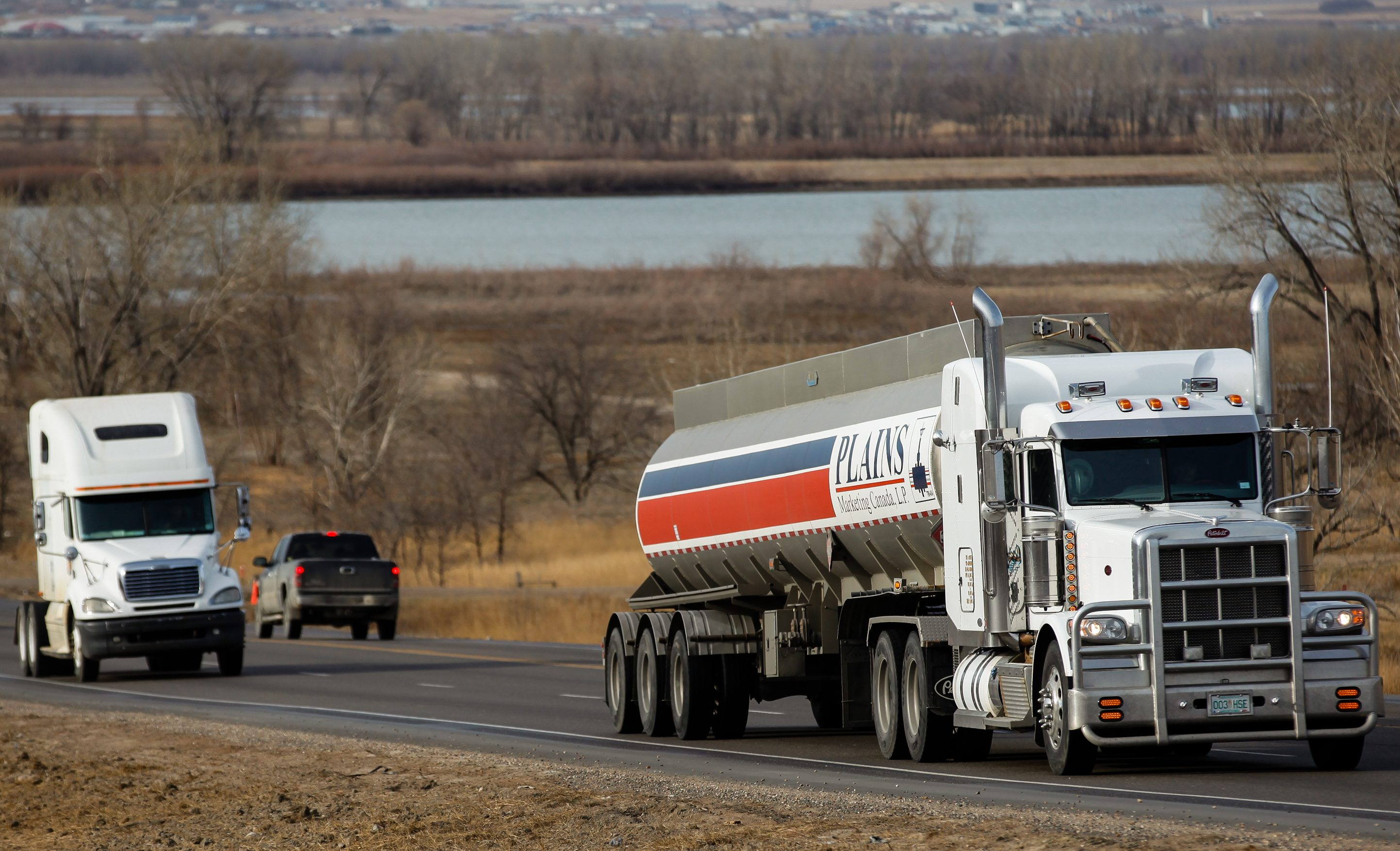 In this March 23, 2012, photo semi-trucks drive south on Highway 85 near Williston, N.D. Litter has become an escalating problem as the rush to tap vast caches of crude escalates in North Dakota. Some of the industrial rubbish blows in from unsecured truckloads, but for many, the most frustrating trash is the gallons of discarded urine. (AP Photo/Elijah Nouvelage)