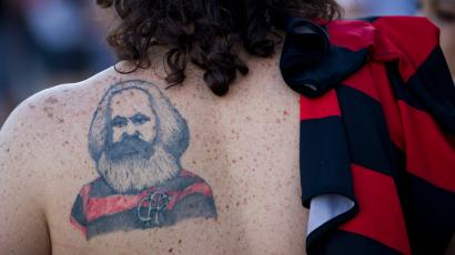 A woman with a Karl Marx tattoo