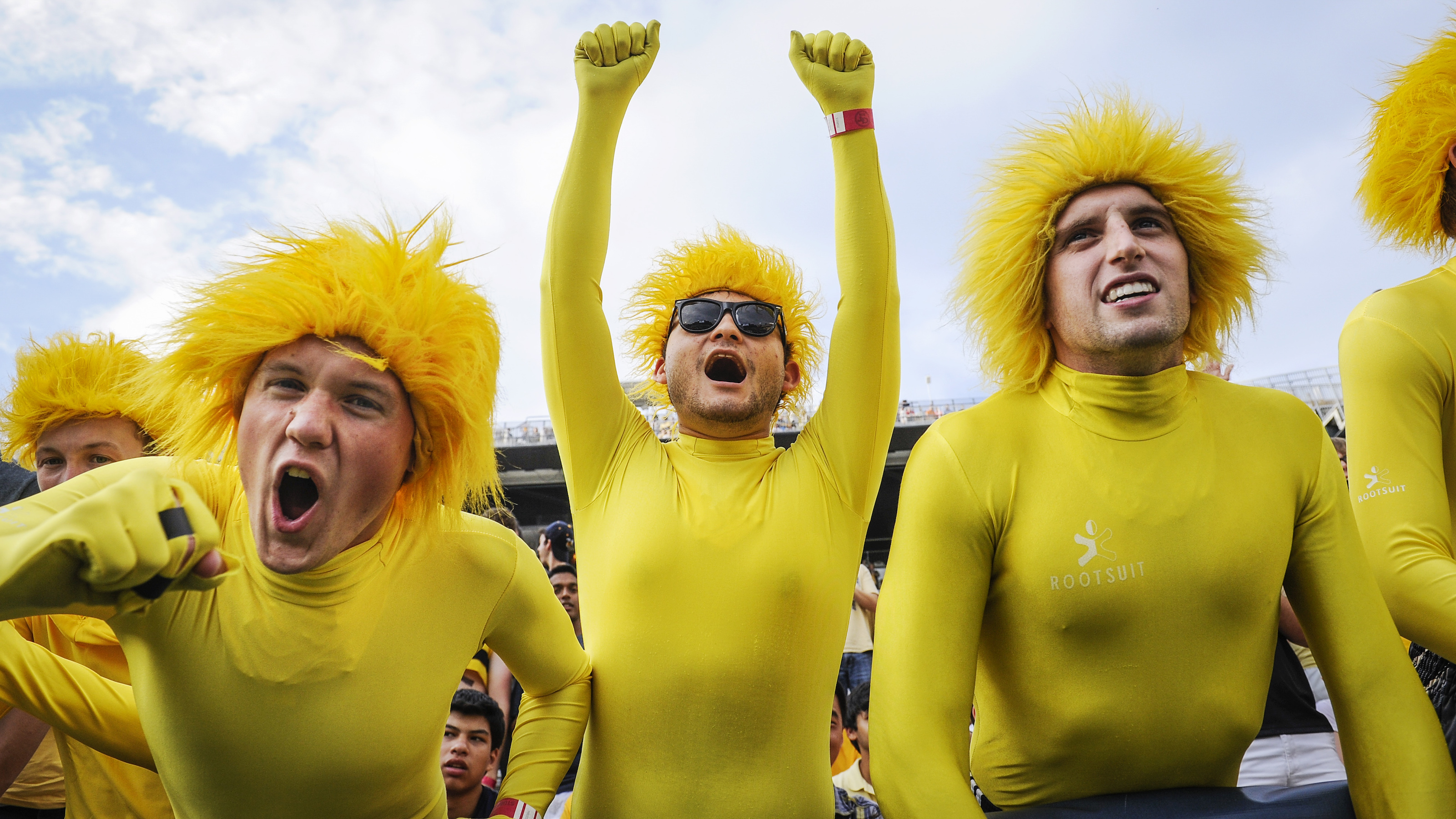 Georgia Tech students Joe Sobchuk, left, David Gaitan, and Matt Schwartz, right, cheer as their team comes on the field before the start of an NCAA college football game against Alcorn State, Thursday, Sept. 3, 2015, in Atlanta. (AP Photo/John Amis)