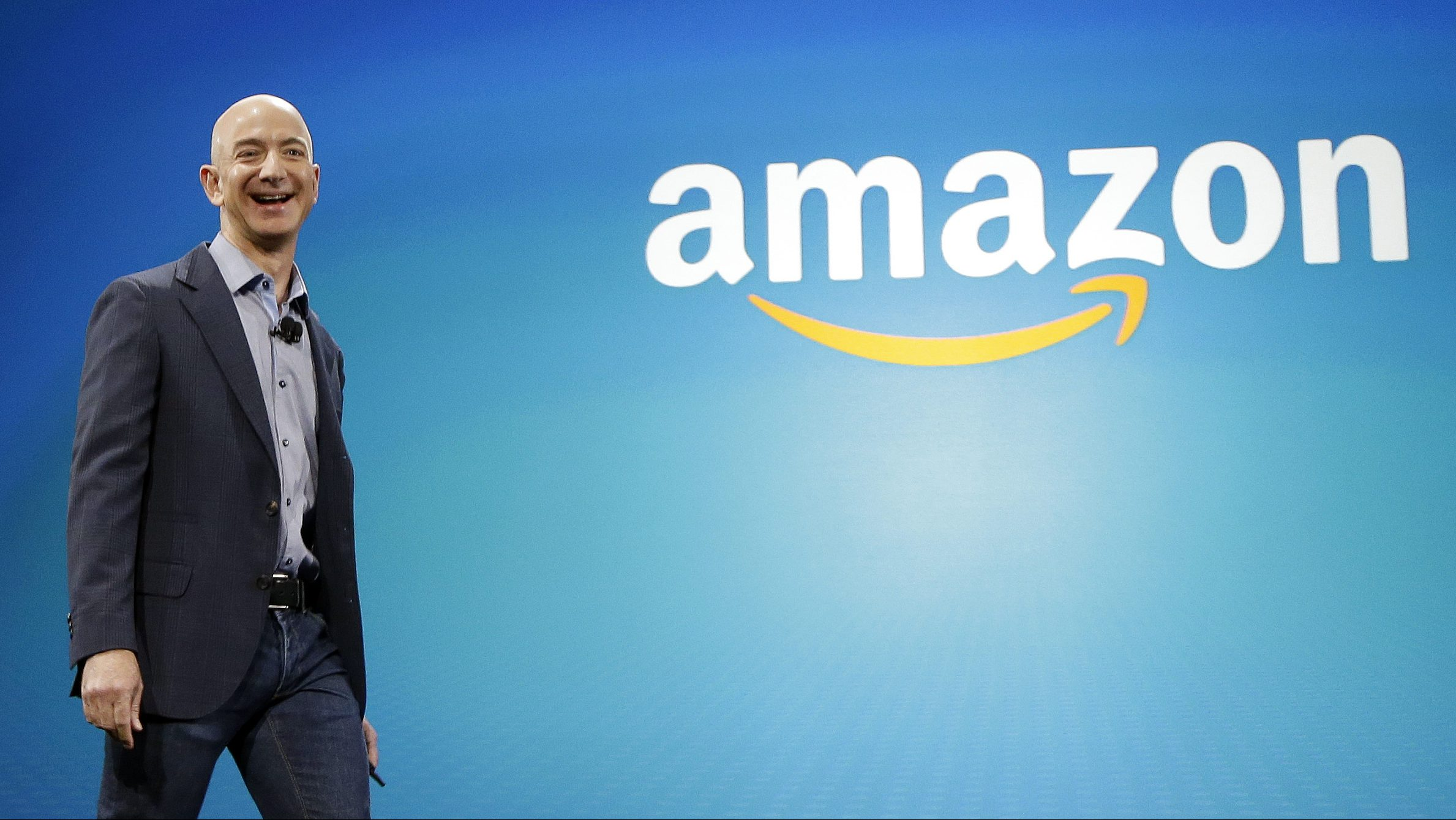 FILE - In this June 16, 2014, file photo, Amazon CEO Jeff Bezos walks onstage for the launch of the new Amazon Fire Phone, in Seattle. Bezos offered a glimpse of his vision for the future during an interview on May 31, 2016, at the Code Conference in Rancho Palos Verdes, Calif. (AP Photo/Ted S. Warren, File)