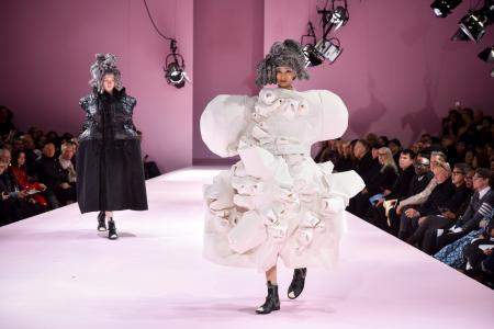 Models wear creations for Comme des Garcons Fall-Winter 2017/2018 ready to wear fashion collection presented Saturday, March 4, 2017 in Paris. (AP Photo/Zacharie Scheurer)