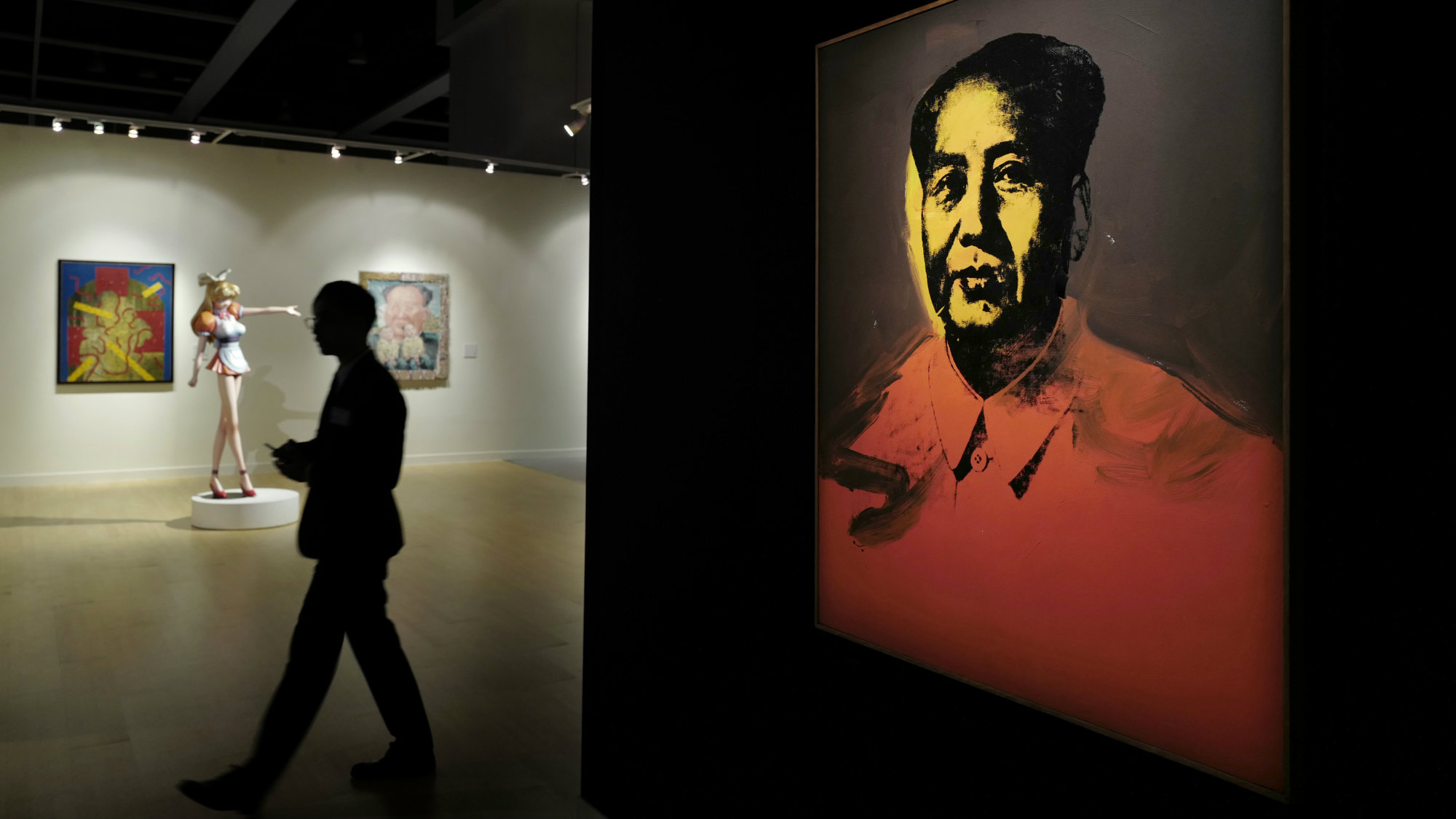 "A man walks past a painting ""Mao"" by U.S. pop artist Andy Warhol during a media preview for the Sotheby's Modern and Contemporary Art Evening Sale in Hong Kong, Friday, March 31, 2017."