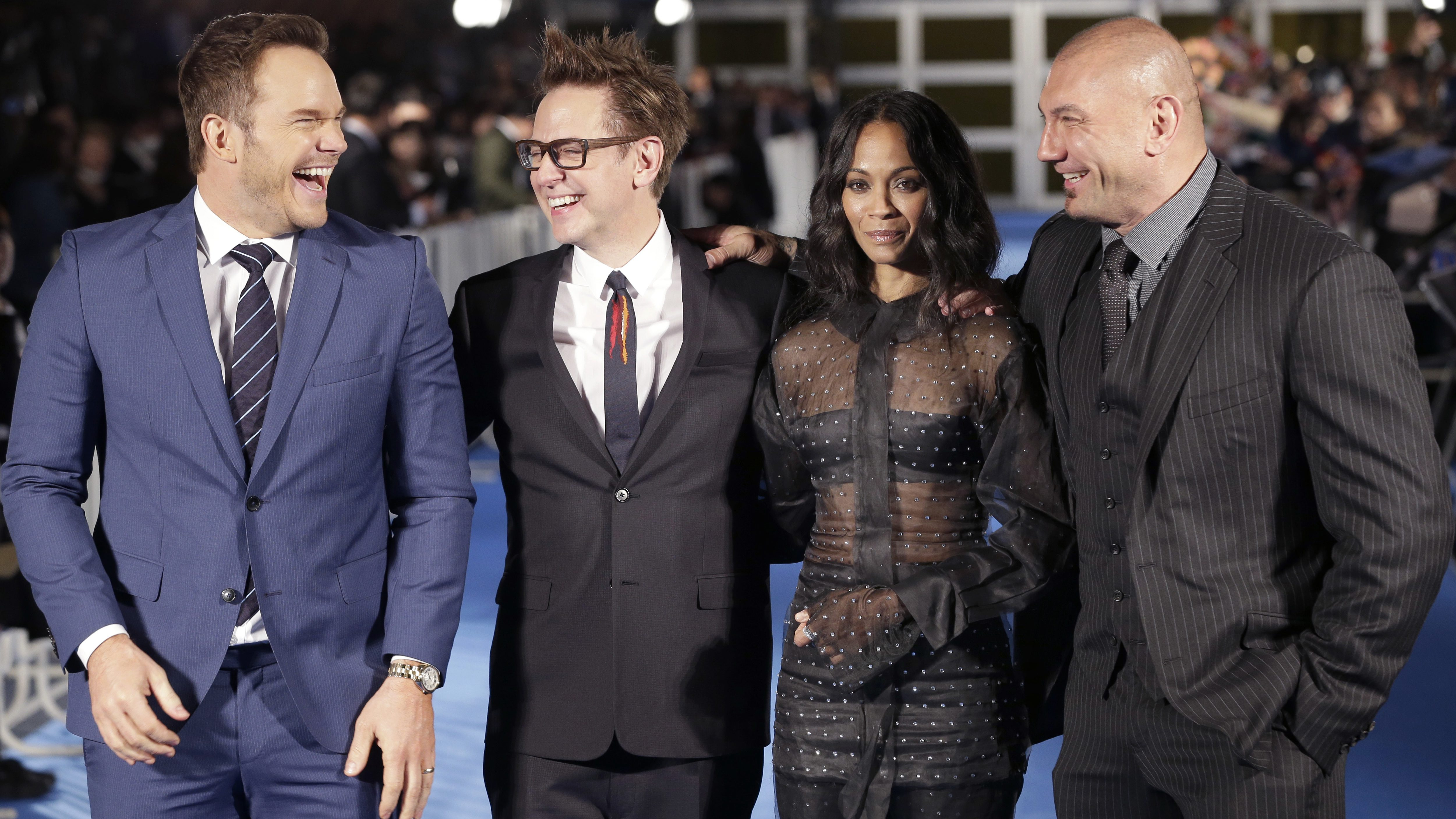 "Director James Gunn, second left, laughs with American actors, from left, Chris Pratt, Zoe Saldana and Dave Bautista, as they pose for photographers during Japan premiere of ""Guardians of the Galaxy Vol. 2"" in Tokyo, Monday, April 10, 2017. (AP Photo/Shizuo Kambayashi)"