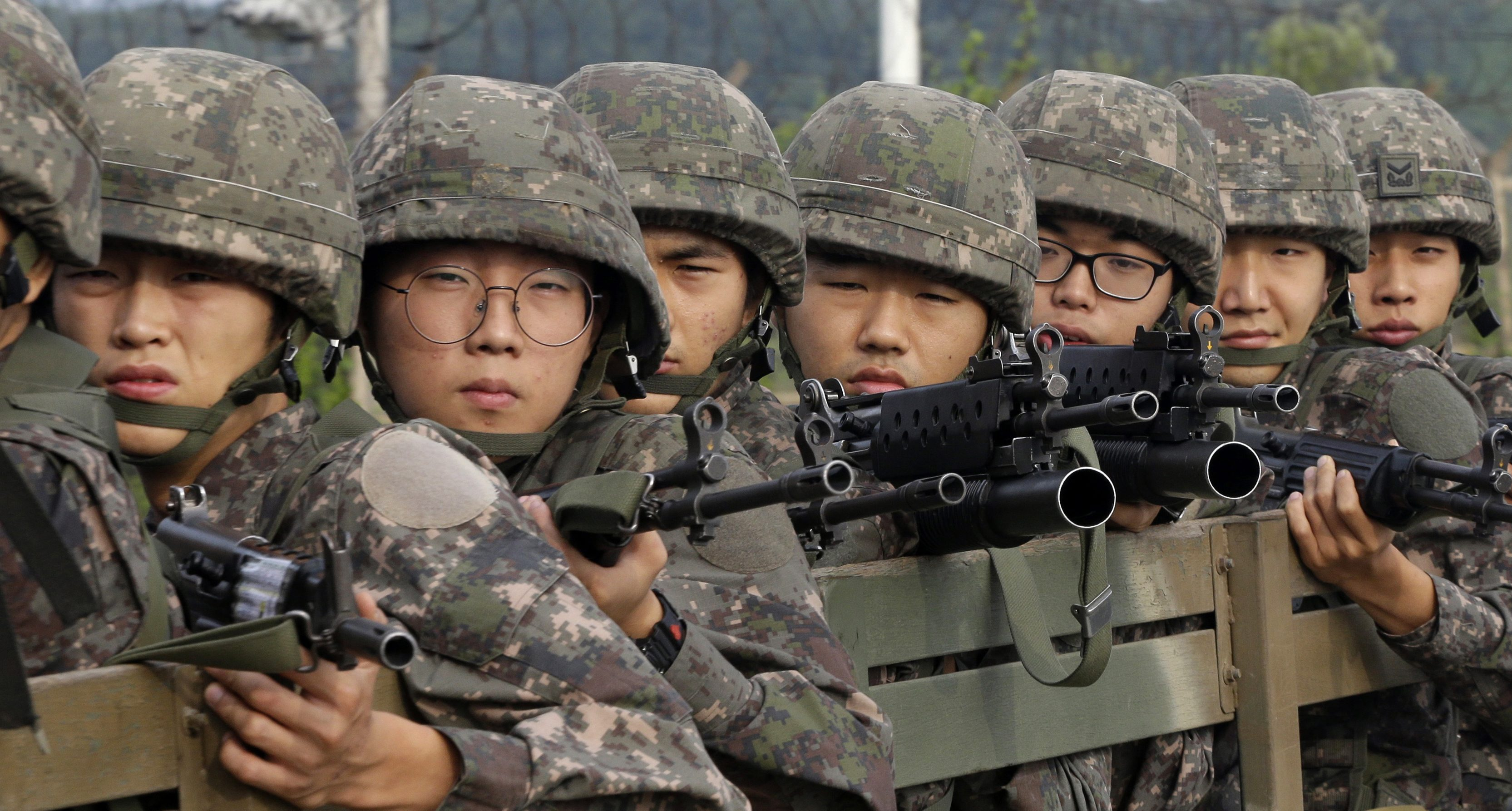 South Korean army soldiers ride on a truck in Paju, south of the demilitarized zone that divides the two Koreas, South Korea, Monday, Aug. 24, 2015.