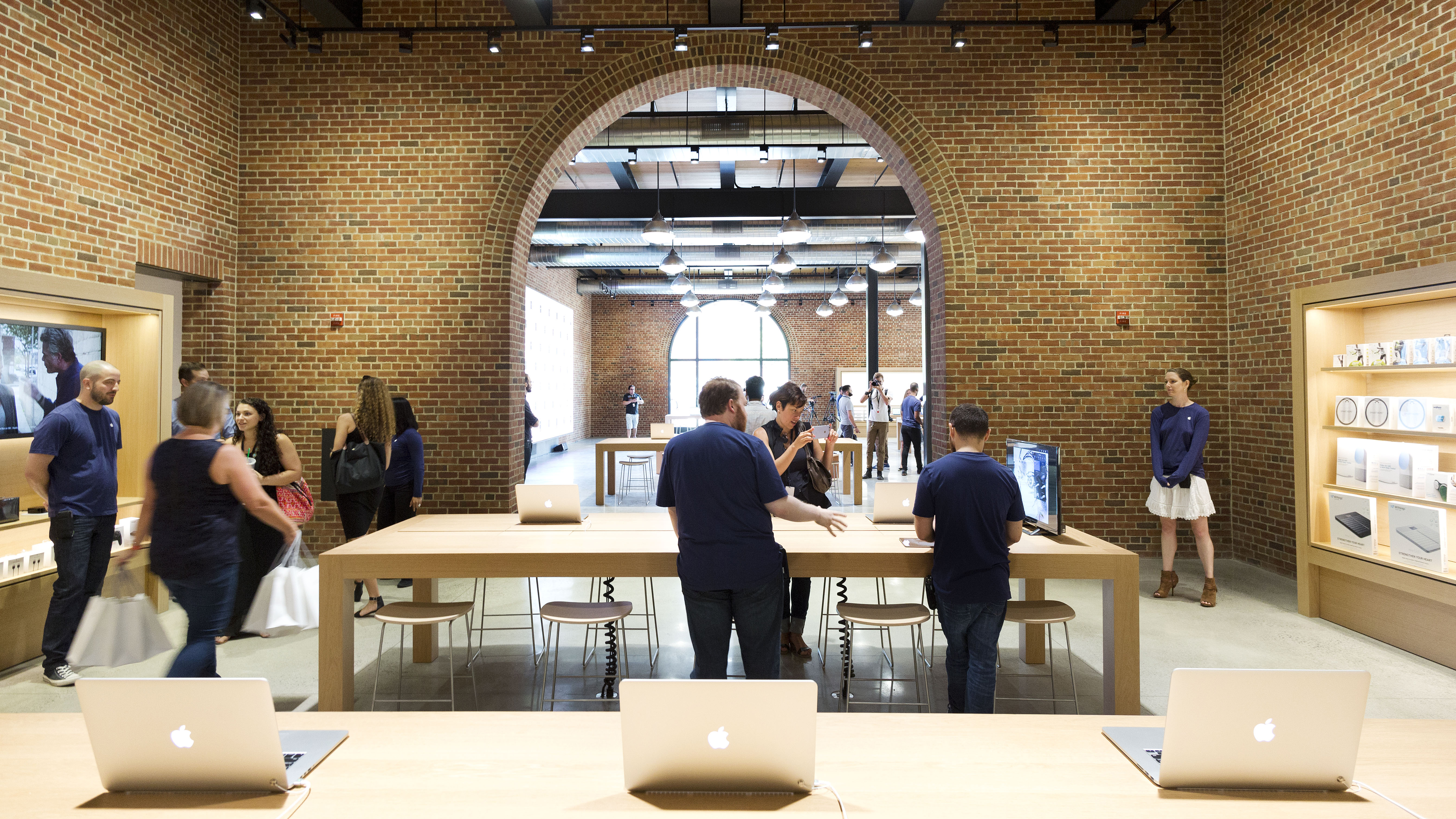A new Apple Store is open for a media preview, Thursday, July 28, 2016 in the Williamsburg section in the Brooklyn borough of New York. The store opens to the public Saturday. (AP Photo/Mark Lennihan)