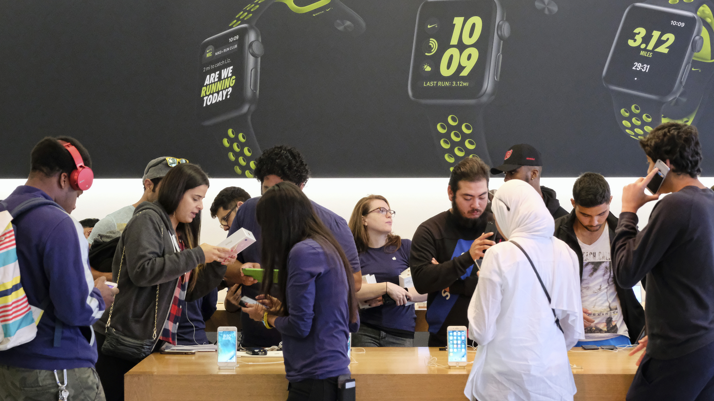 Customers check out the new Apple iPhone 7 at the Apple Store at the Grove in Los Angeles on Friday, Sept. 16, 2016. The latest Apple Watches and iPhone 7 were released Friday. (AP Photo/Richard Vogel)