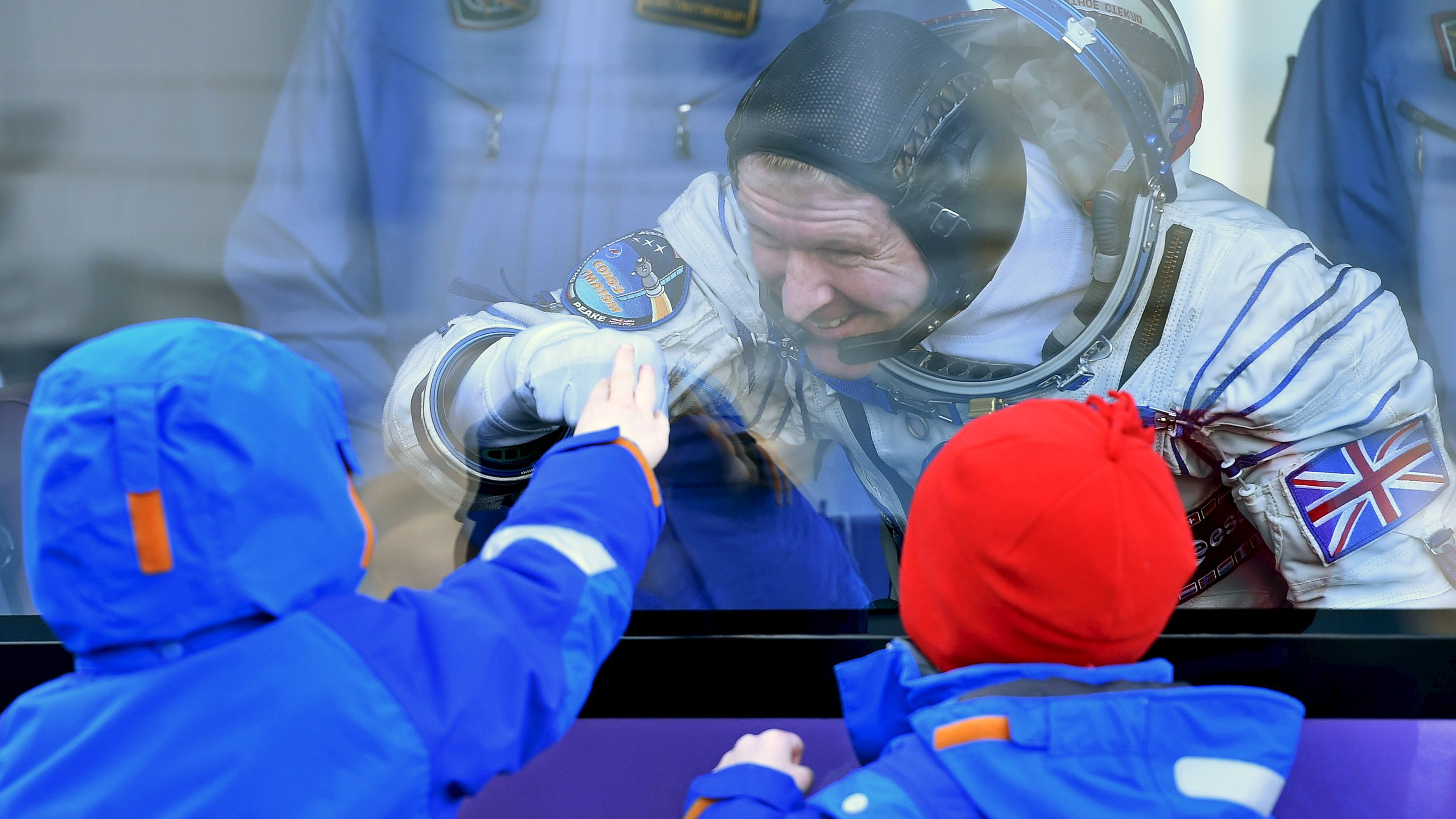Member of the International Space Station expedition 46/47, British ESA astronaut Timothy Peake gestures to his children during a sending-off ceremony at the Baikonur cosmodrome in Kazakhstan, 15 December 2015, before travelling on board the Soyuz TMA-19M spacecraft to the International Space Station (ISS).