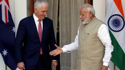 India's PM Modi extends his hand for a handshake with his Australian counterpart Turnbull during a photo opportunity ahead of their meeting at Hyderabad House in New Delhi