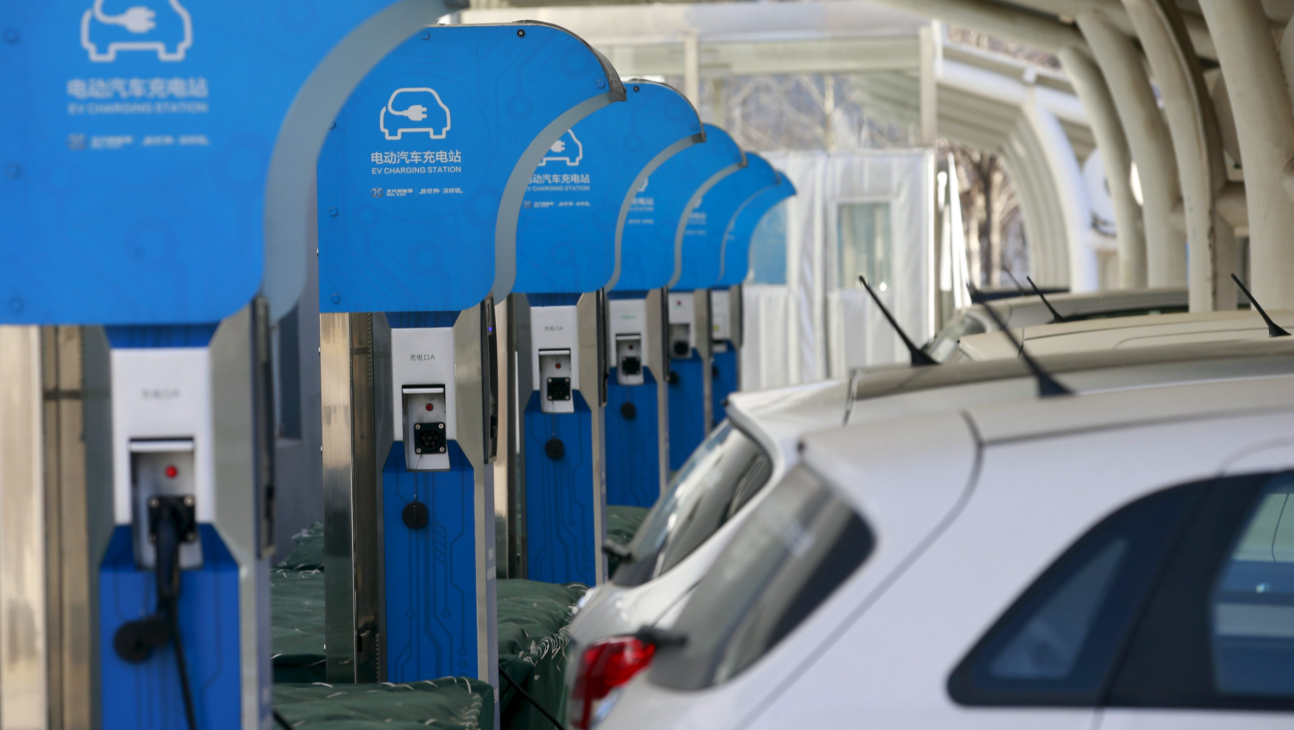An Electric Vehicle (EV) charging station is seen at a factory of Beijing Electric Vehicle, funded by BAIC Group, in Beijing, China, January 18, 2016. Picture taken January 18. REUTERS/Kim Kyung-Hoon
