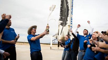 Bezos and his team celebrate the first successful landing of the New Shepard rocket booster.