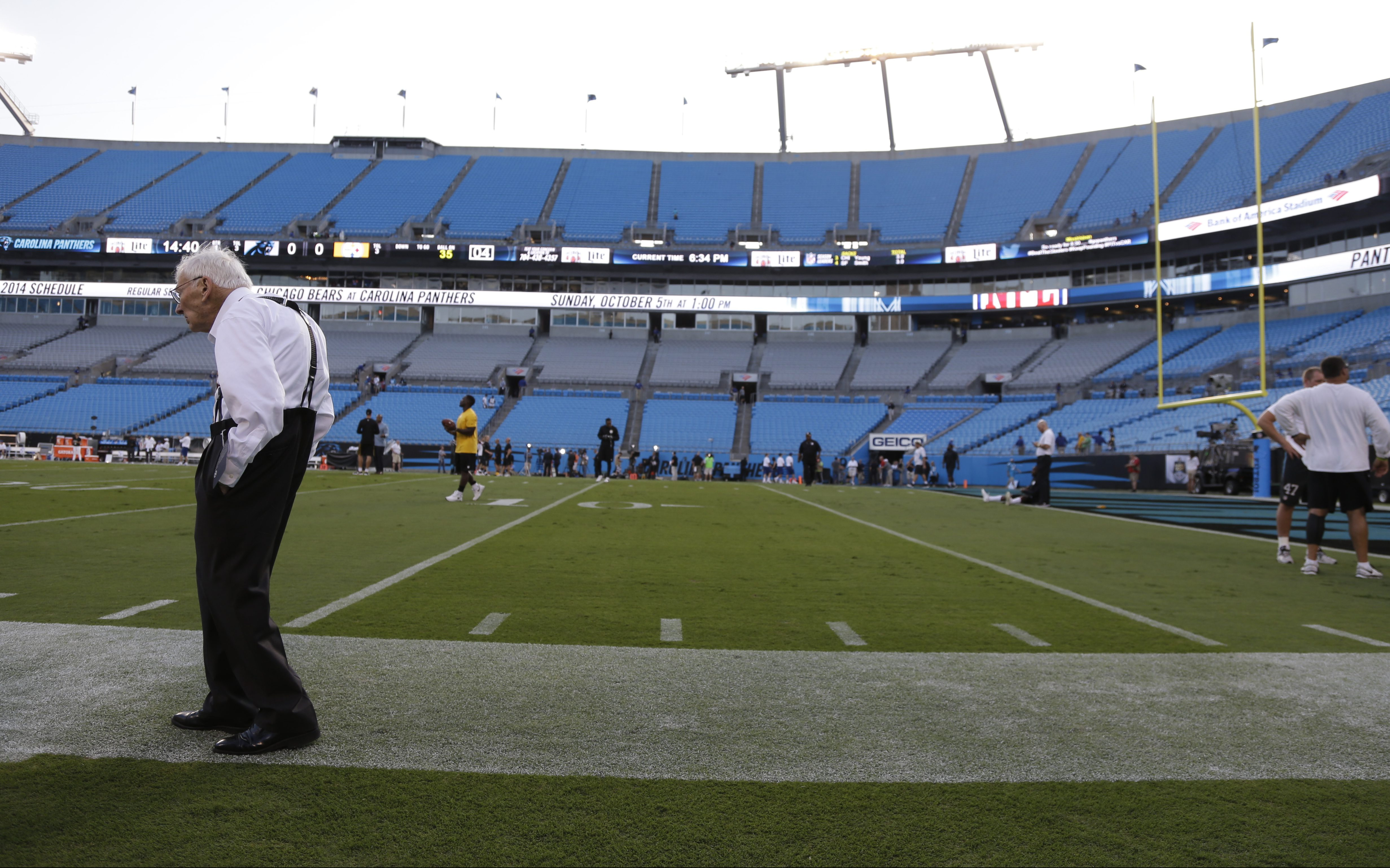 Pittsburgh Steelers chairman Dan Rooney walks down the field as players warm up before an NFL football game against the Carolina Panthers in Charlotte, N.C., Sunday, Sept. 21, 2014.