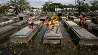 Running in a flooded cemetery.