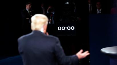 Republican U.S. presidential nominee Donald Trump speaks as a clock counts down during the presidential town hall debate with Democratic U.S. presidential nominee Hillary Clinton at Washington University in St. Louis, Missouri, U.S., October 9, 2016.